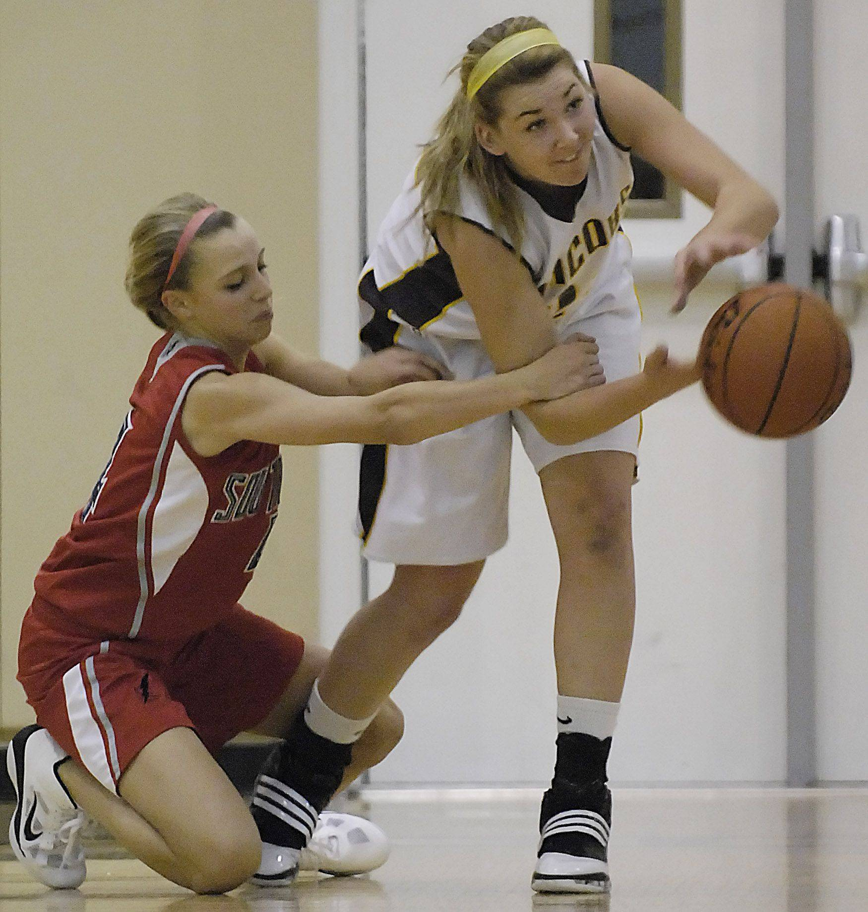 South Elgin's Savanah Uveges fouls Jacobs' Melanie Schwerdtmann Wednesday in Algonquin.