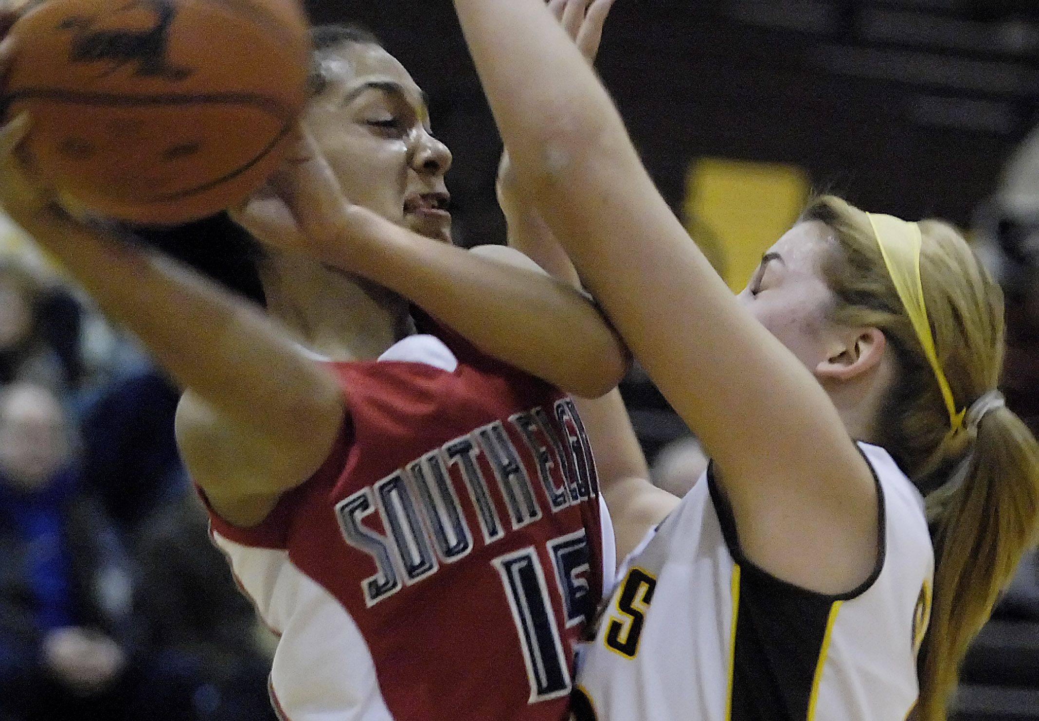 South Elgin's Becca Smith tries to pass around Jacobs' Melanie Schwerdtmann Wednesday in Algonquin.