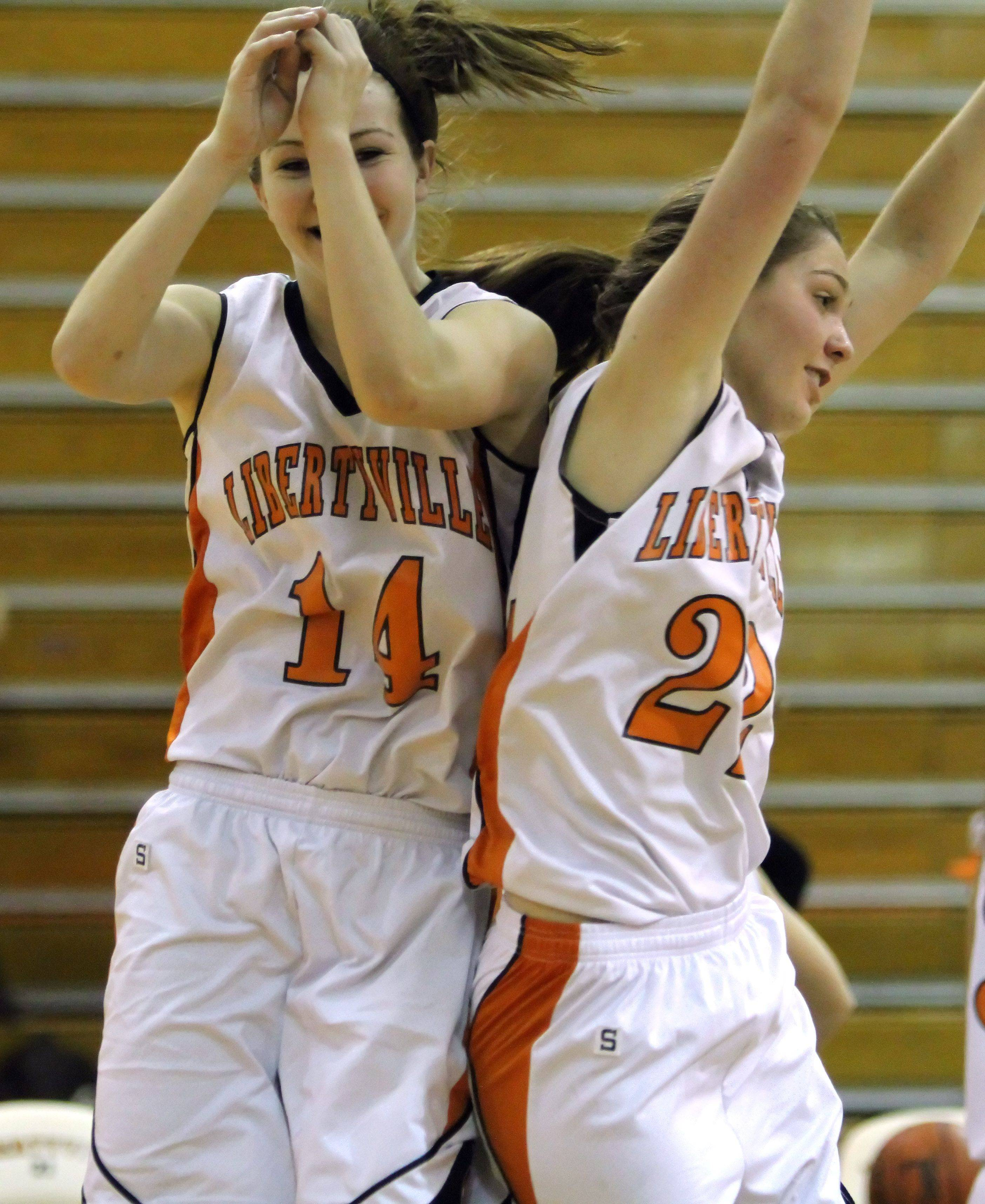 Libertyville's Savanna Trees, left, and Olivia Wilcox celebrate after beating Zion-Benton Wednesday at Libertyville High School.