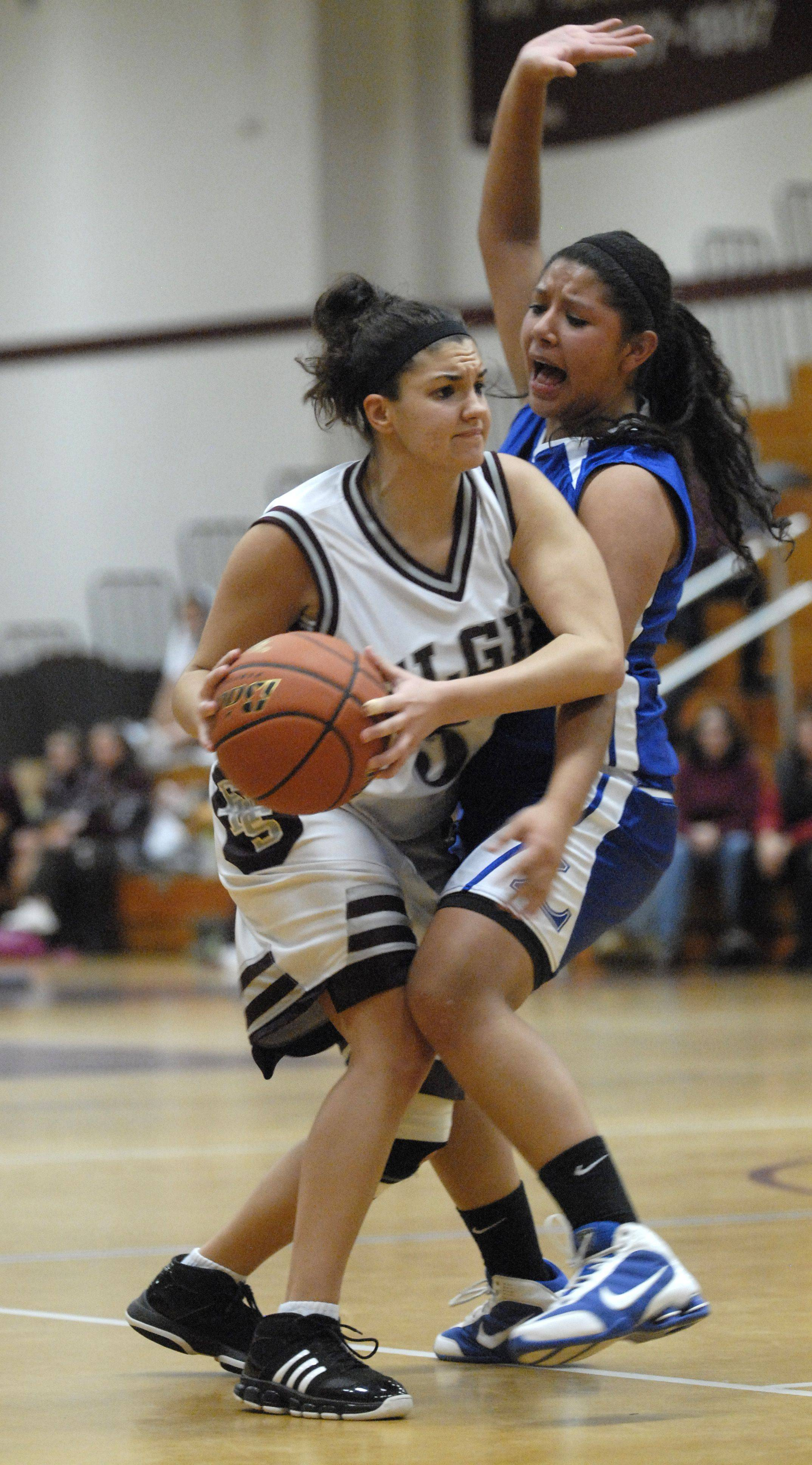 Jill Howe of Elgin searches for her next pass while defending Abigail Alvarez of Larkin Thursday evening.