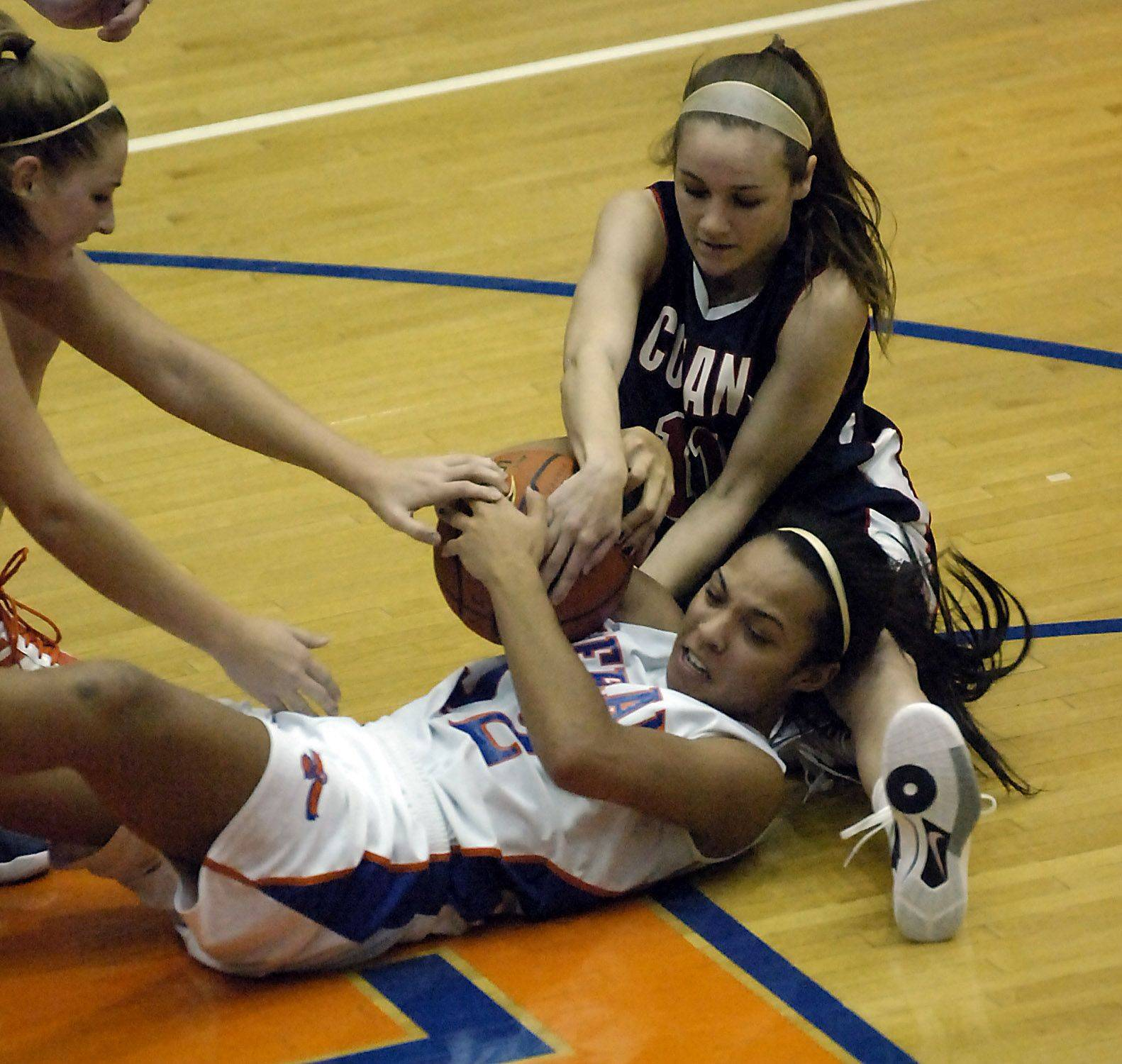 Conant's Hailey Andress and Hoffman Estates' Jada Stotts battle for the ball Friday.