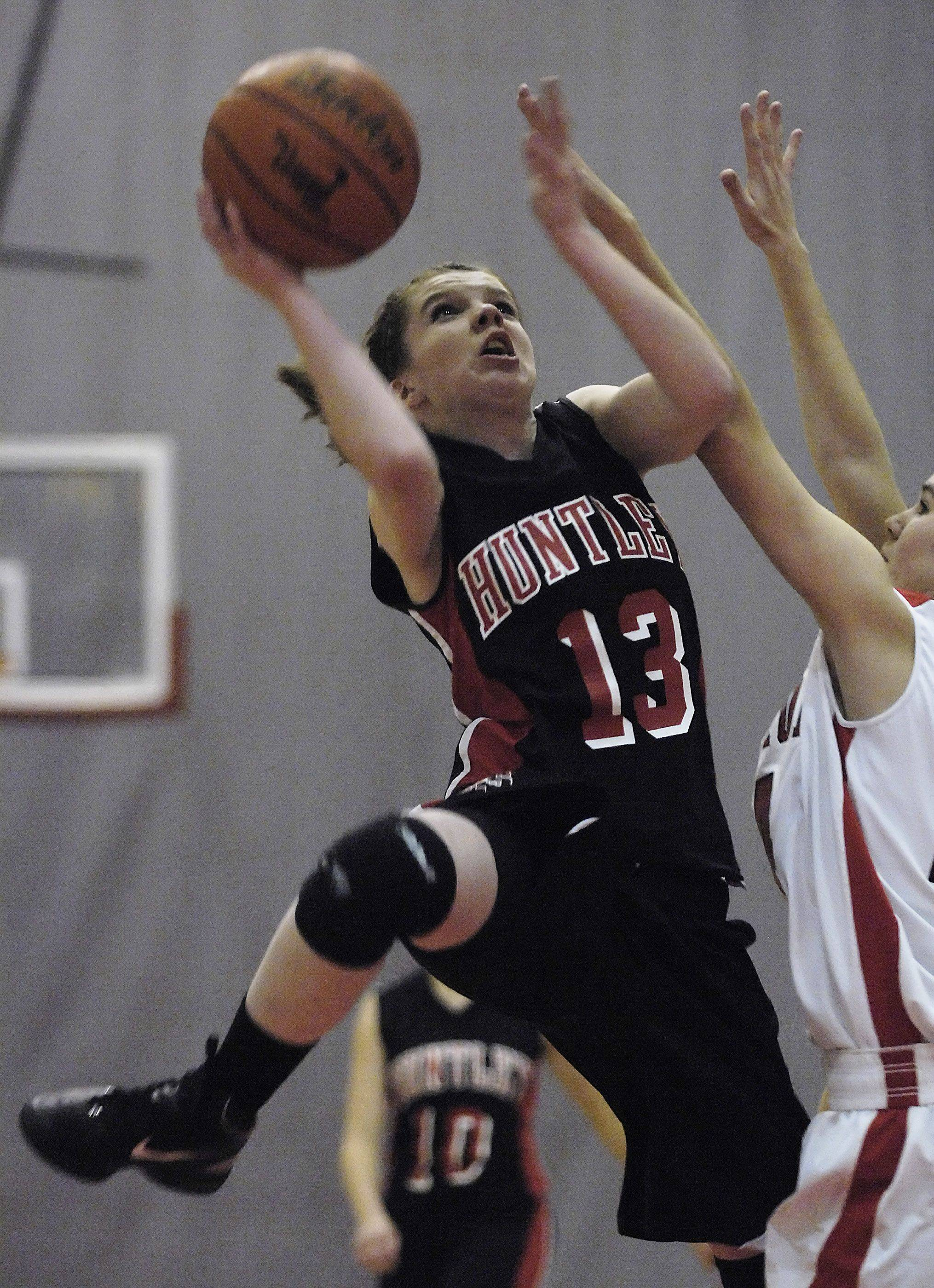Huntley's Meagan Flynn is able to get around Barrington's Nicole Collins for a basket Tuesday.