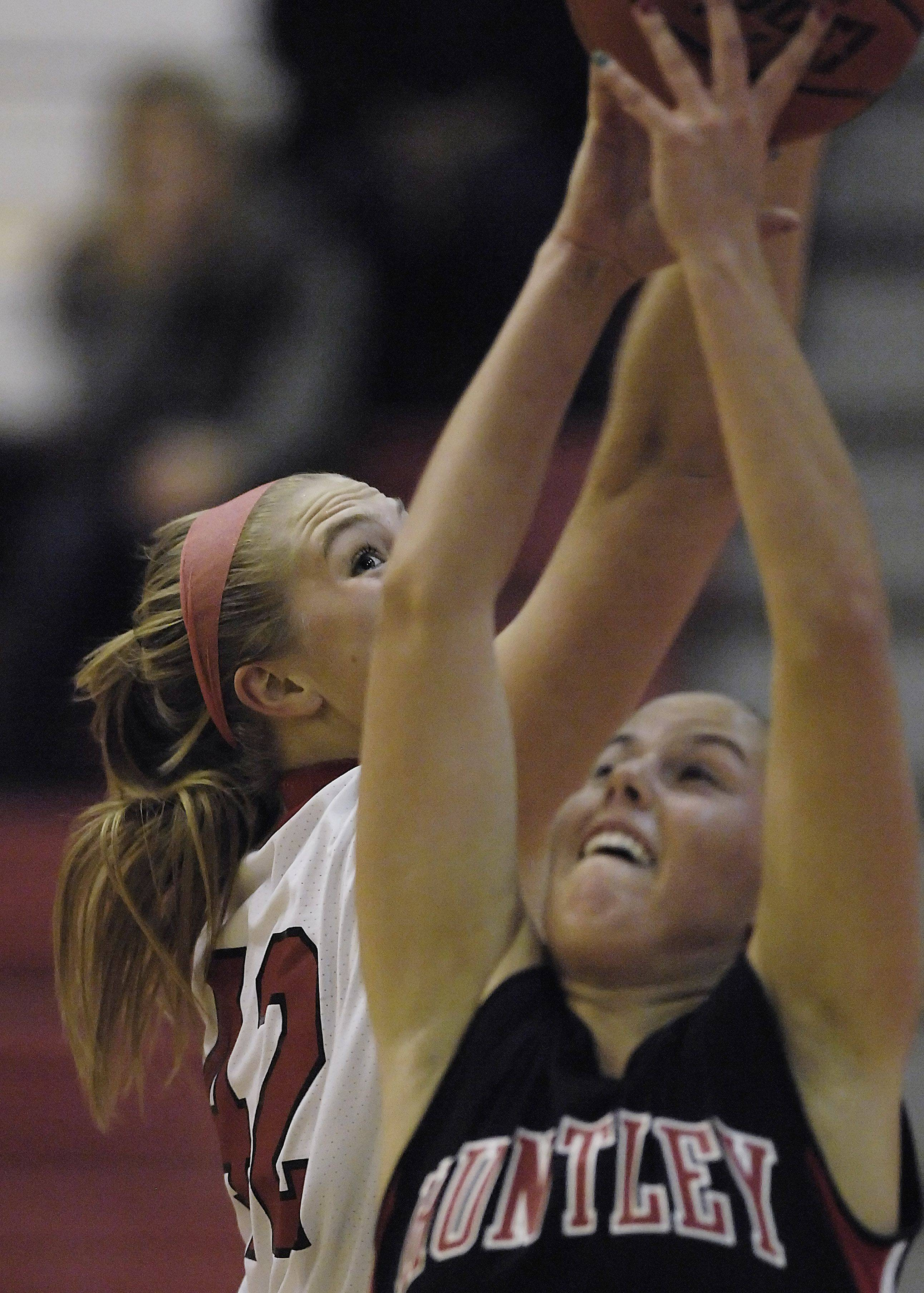 Barrington's Shelby Whigham keeps her eye on the ball as she stretches for a rebound against Huntley's Rachel Chapuis Tuesday.