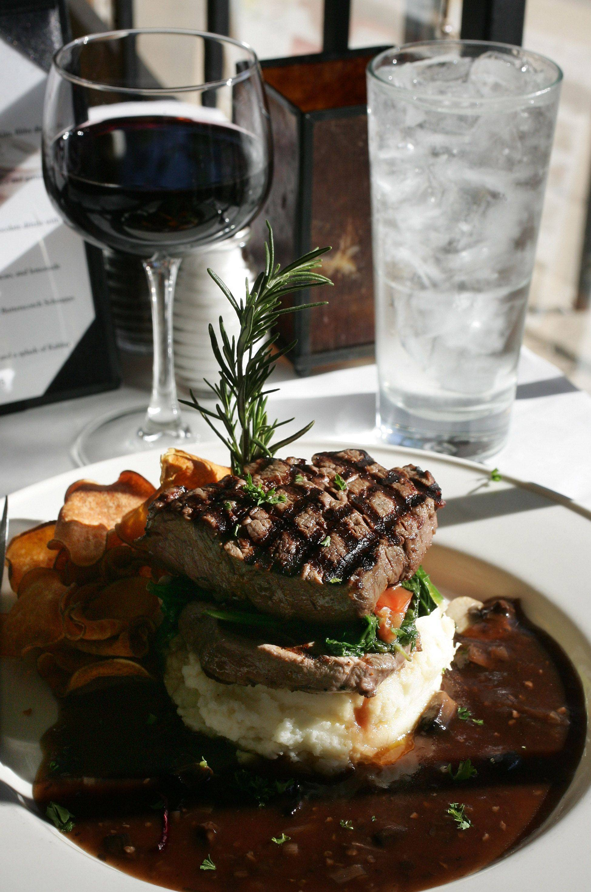 A filet stuffed with spinach, caramelized onions, tomatoes and chevre cheese is one of the beautifully rendered dishes at David's Bistro in Antioch.