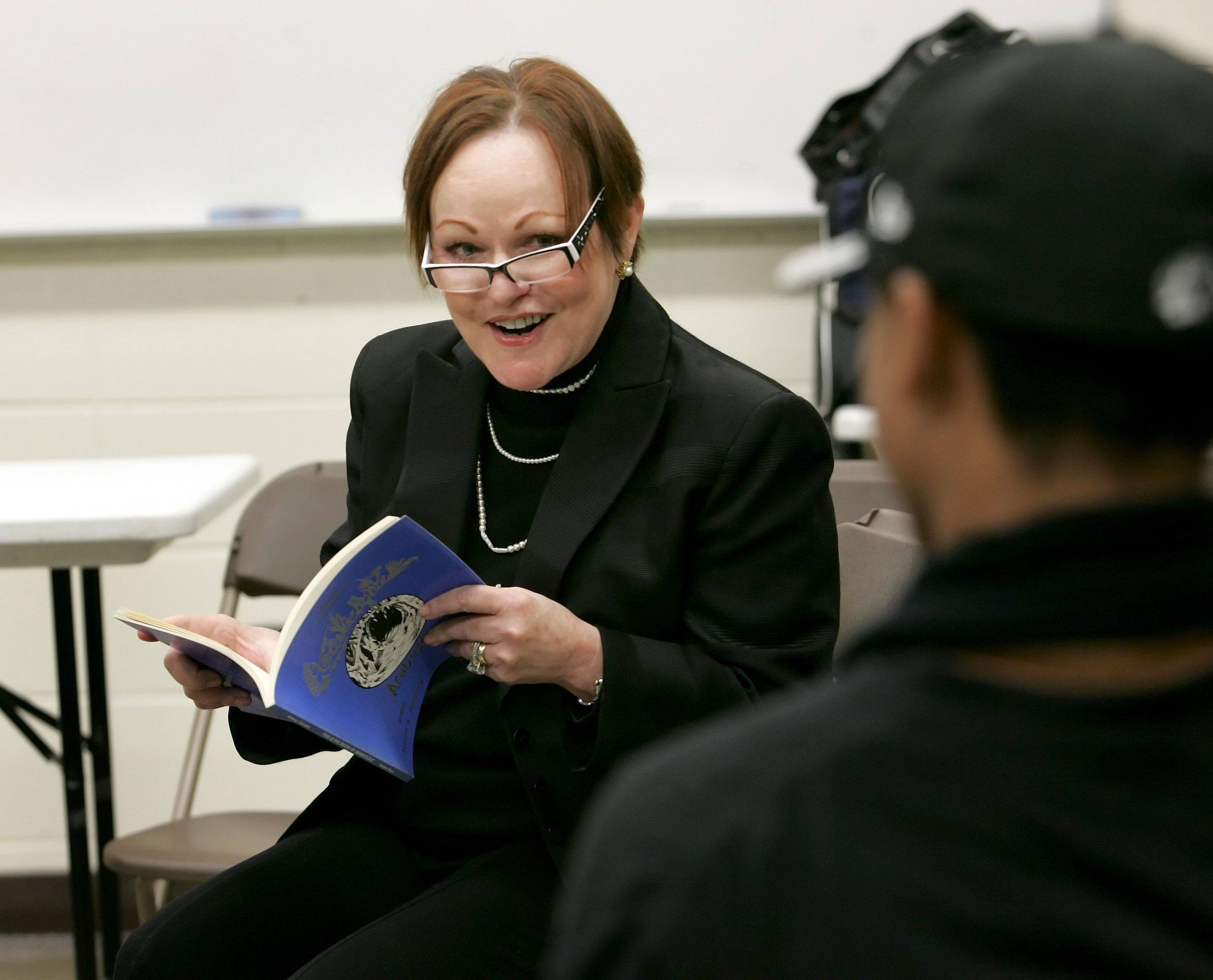 "Wrigley heiress Helen Rosburg reads a poem from her collection ""This is the Book of Arabesque"" to East Aurora High School students during a workshop Tuesday."