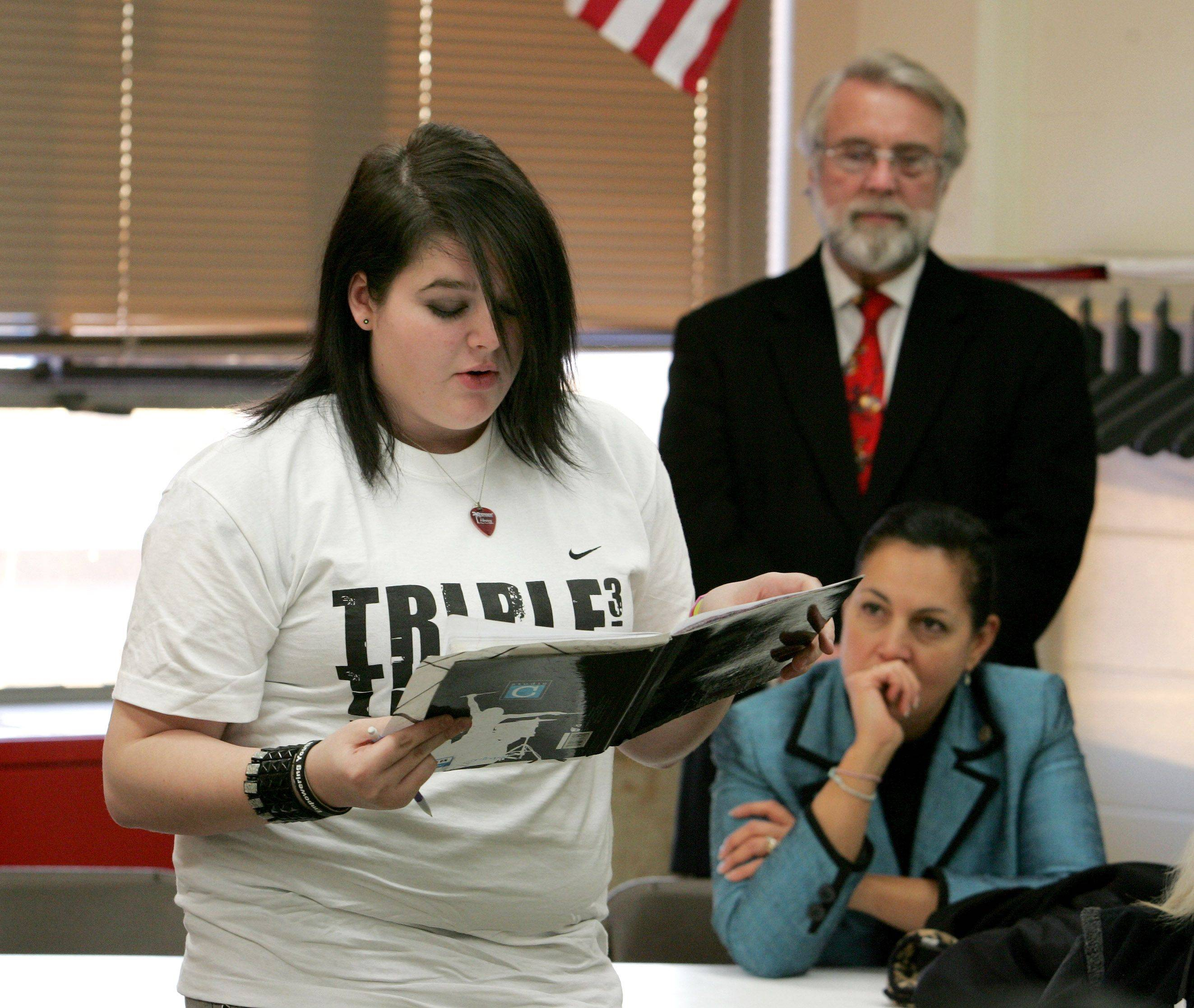 Aurora Mayor Tom Weisner and State Rep. Linda Chapa La Via listen as sophomore Daniell Steward reads one of her poems during a workshop with writer and Wrigley heiress Helen Rosburg at East Aurora High School on Tuesday.