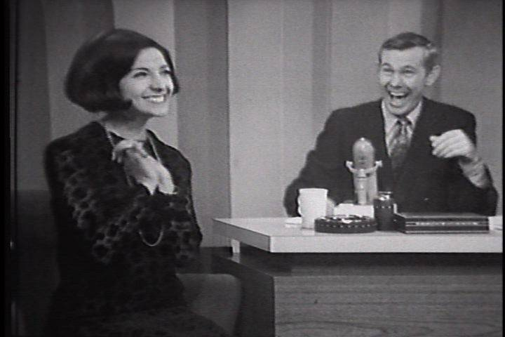 Erupting in laughter, Johnny Carson listens to Mona Abb