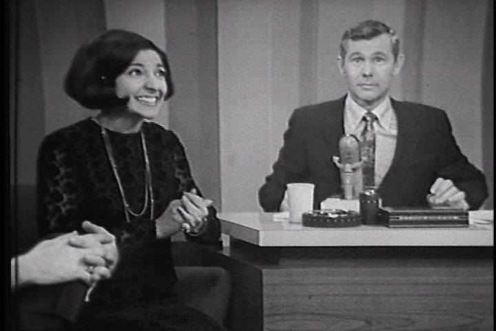 "His eyes wide in surprise, legendary ""Tonight Show"" host Johnny Carson helps Mona Abboud of Sleepy Hollow win over the audience as she sings her funny Christmas song, ""The Pretty Little Dolly."" That show aired on Dec. 15, 1966, but Abboud's performance is the chosen clip used to lure visitors to the new www.JohnnyCarson.com website."