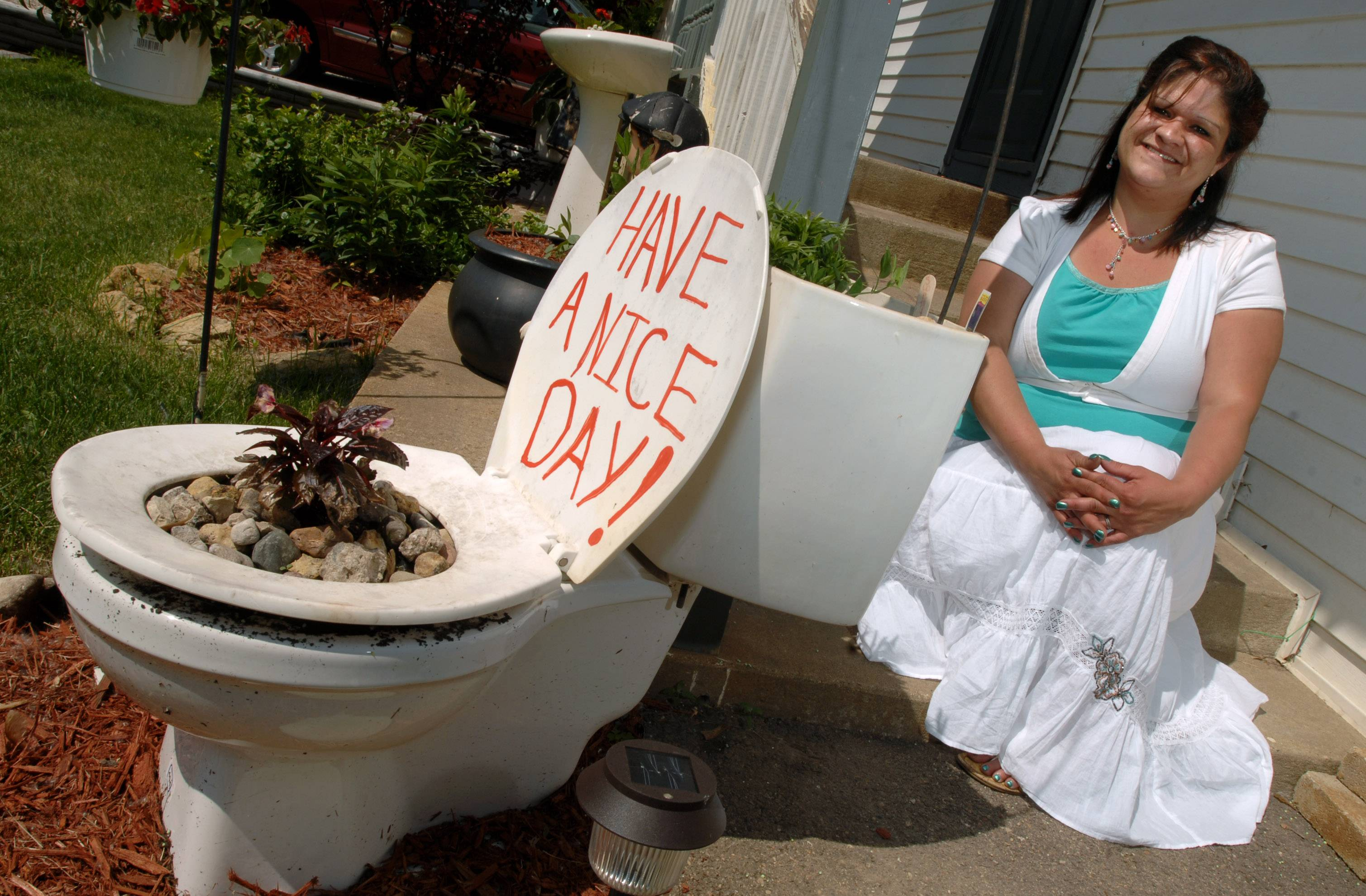 Lakemoor resident Tina Asmus has won the right to use old toilets as planters in her front yard.