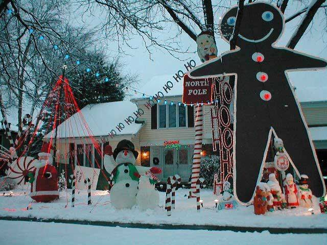 Bruce Mitroff, of 1919 Gladstone Drive in Wheaton, made all of his decorations, including a 24-foot gingerbread man, a 30-foot champagne bottle and 16-foot candy canes.