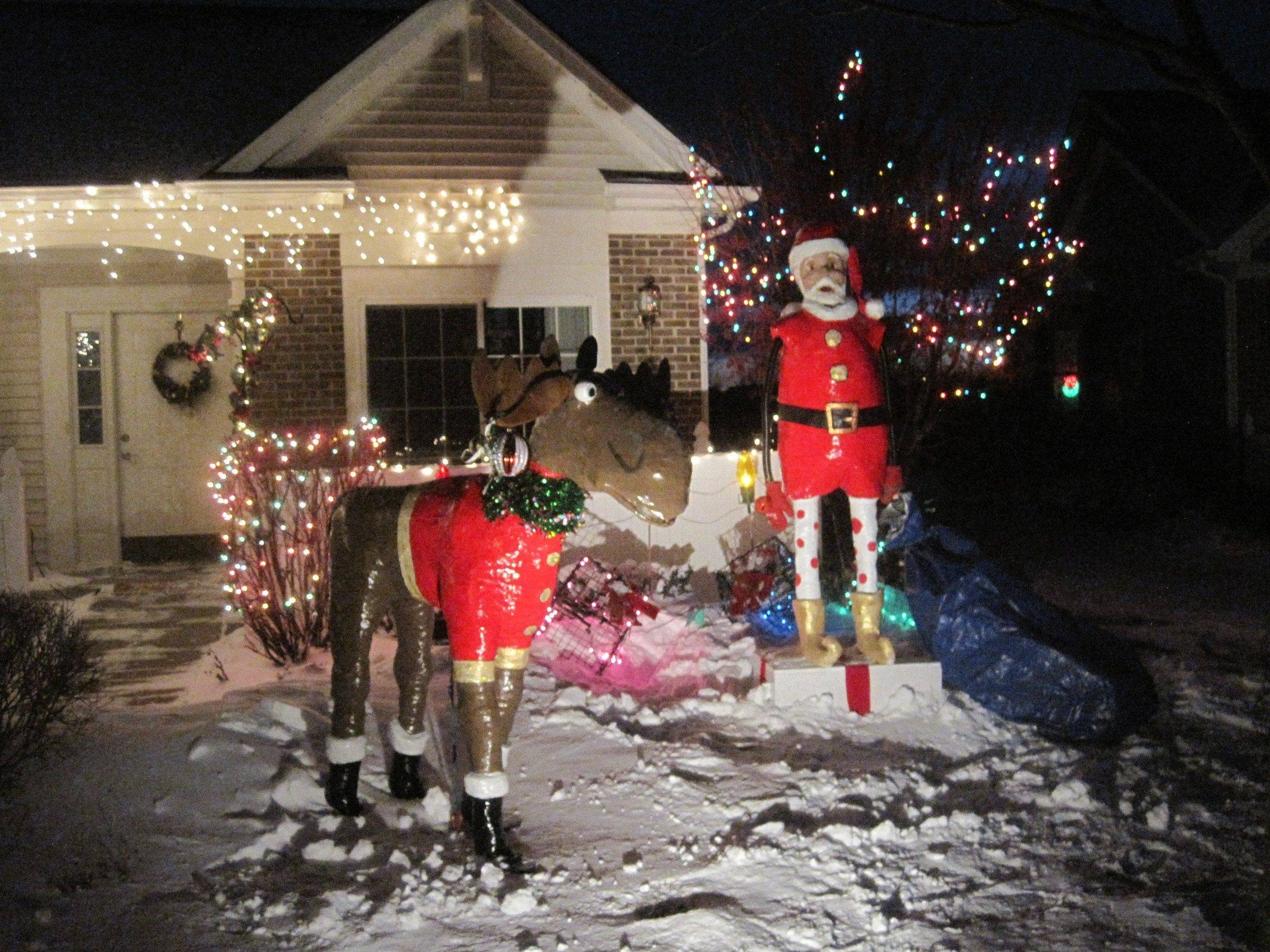 Santa and a reindeer welcome visitors to William Bach's home at 225 Enfield Lane in Grayslake.