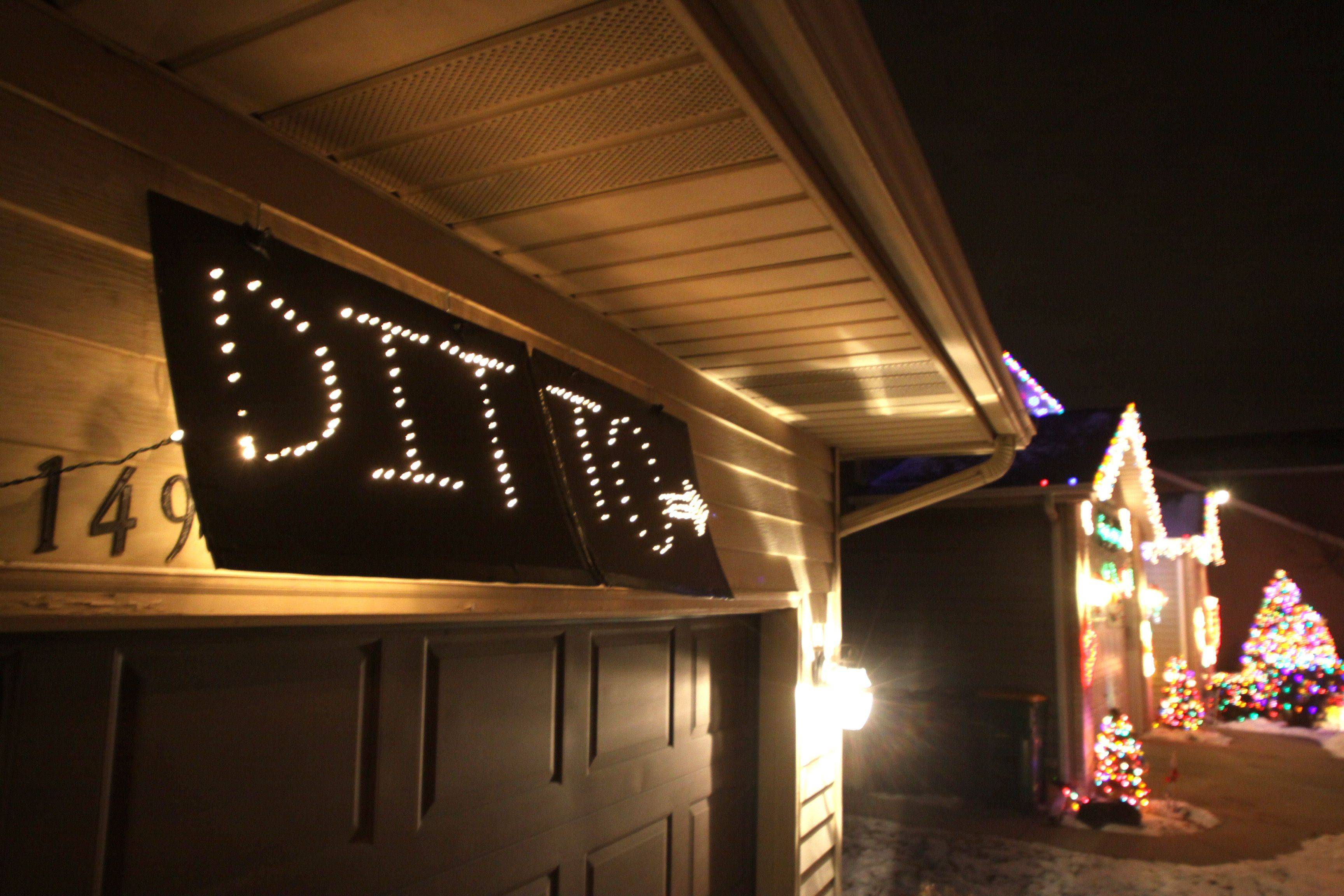 "Bill and Jennifer Kyprianidis are the winners of the 2010 Daily Herald holiday lights contest. Their home is at 1495 Morgan Drive in Elk Grove. This humorous ""ditto"" with an arrow sign is at the house of Robin and Binu Joseph next door."