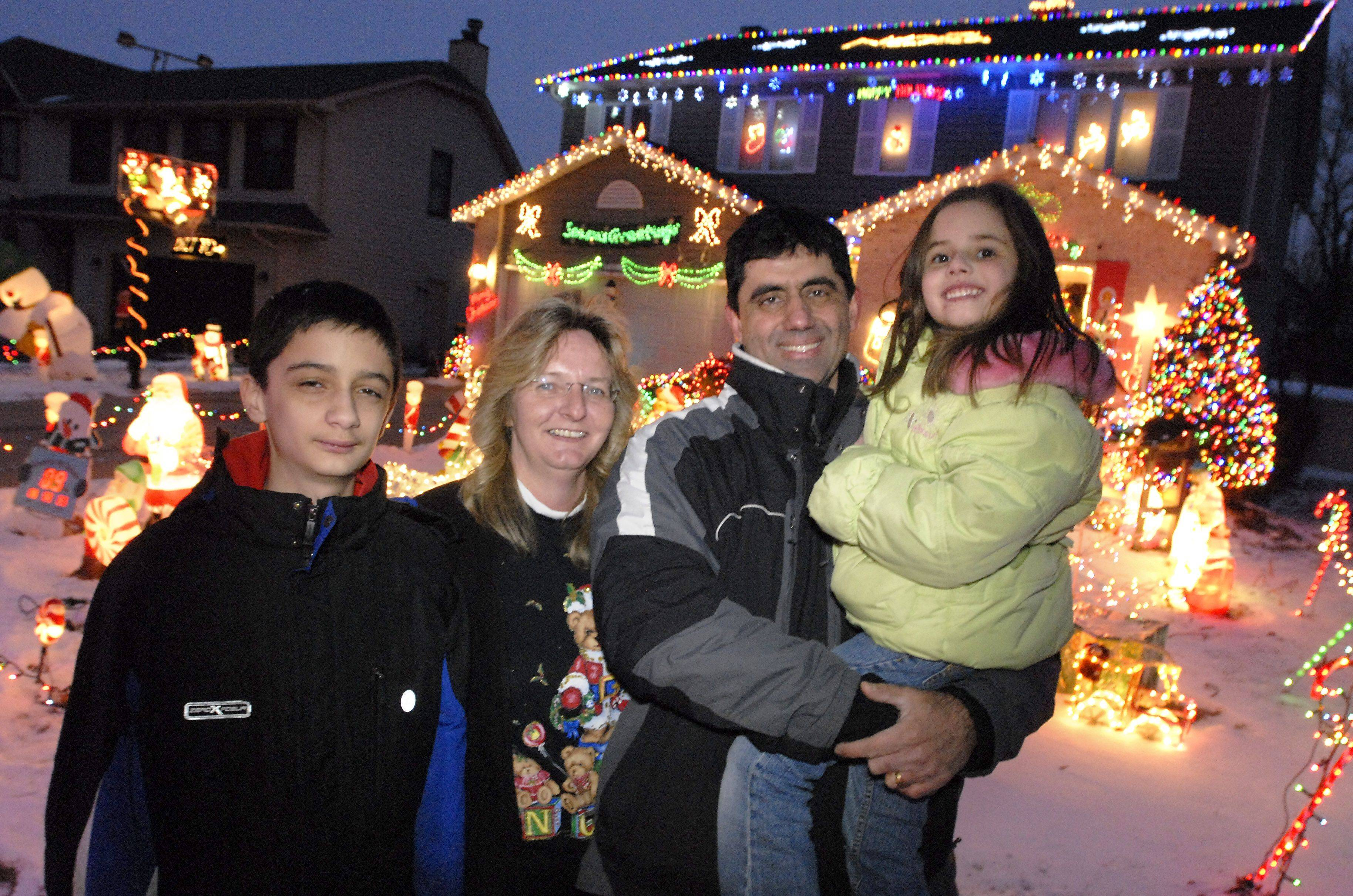 Jennifer and Bill Kyprianidis and children William, 12, and Nia, 5, needed three weeks to put up all the decorations at their Elk Grove Village home.