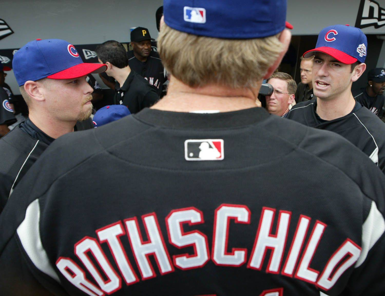 Cubs pitchers Kerry Wood and Mark Prior visit with their pitching coach Larry Rothschild at US Cellular Field during 2003 All-Star Workout Day.