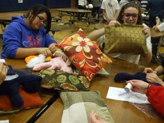 West Oak Middle School students stuffed teddy bears and decorative pillows as part of the District 76 holiday drive.