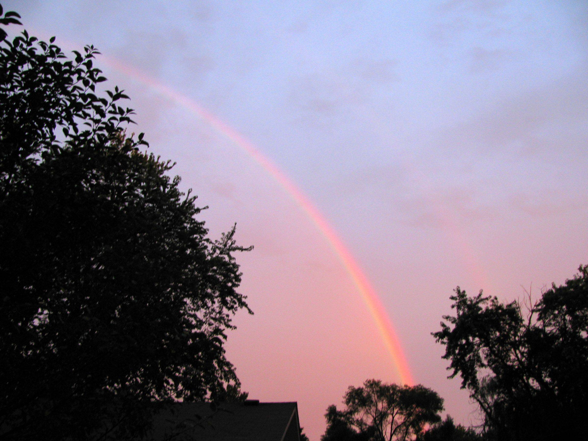 This is a double rainbow at sunrise on an August morning last summer.
