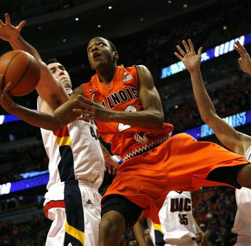 Illinois' Jereme Richmond drives with basket in front of Illinois-Chicago's K.C. Robbins during the first half .