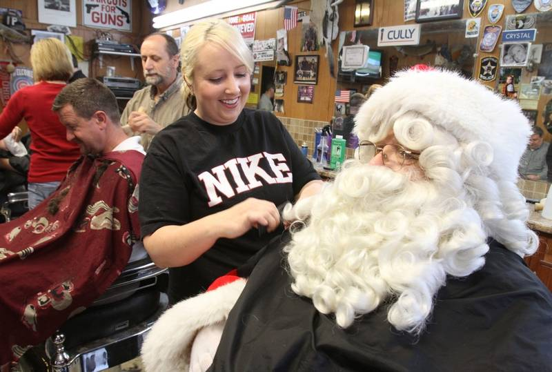 Santa Claus gets a trim from Crystal Hall at Libertyville Barber Shop ...