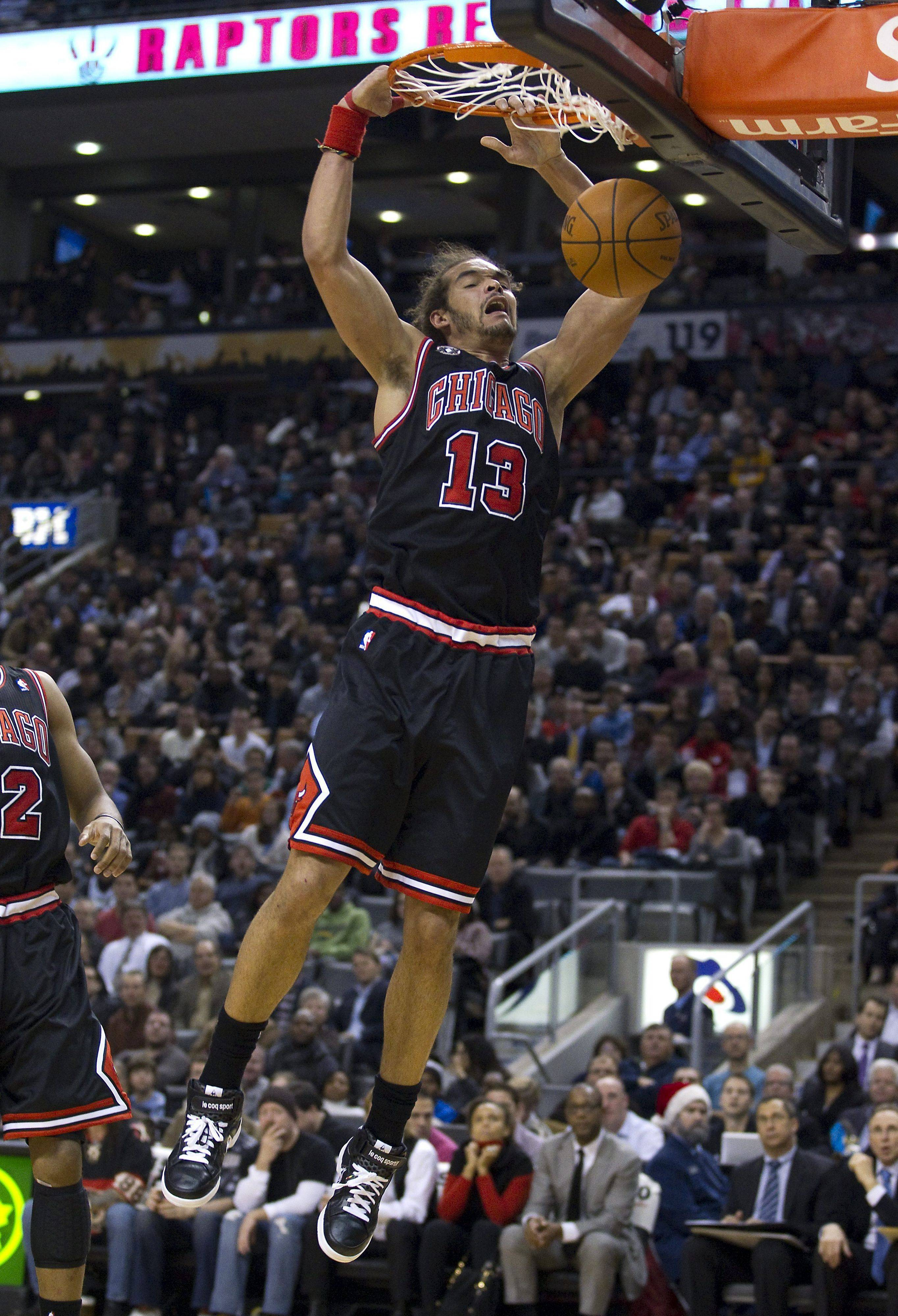 Bulls center Joakim Noah dunks against the Raptors in his final game before undergoing thumb surgery. Noah will be out 8-10 weeks.