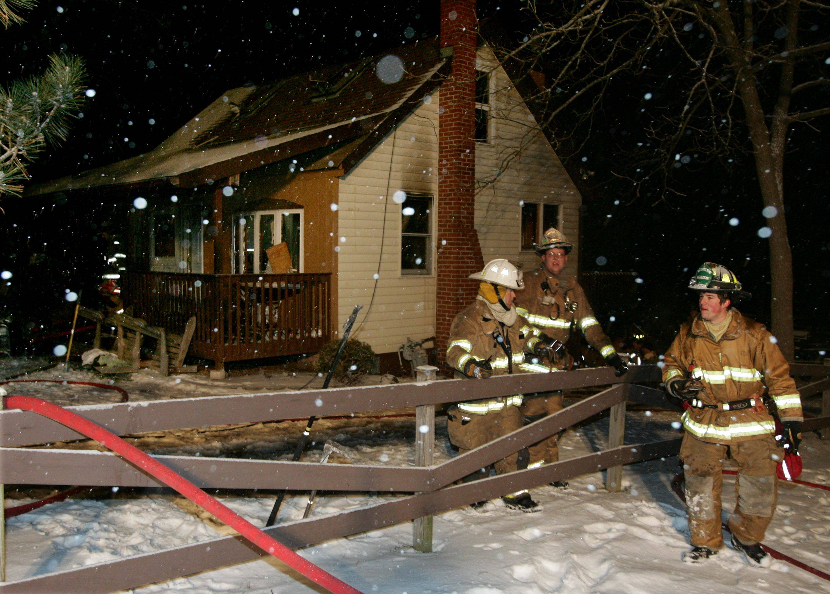 The Antioch Fire Department battles a house fire on the 26300 block of West Prospect Street Monday. The rural fire was called in at 5:12 p.m. and required help from several other departments including Fox Lake, Lake Villa, Round Lake and others. Firefighters battled the blaze as heavy snow fell around them.