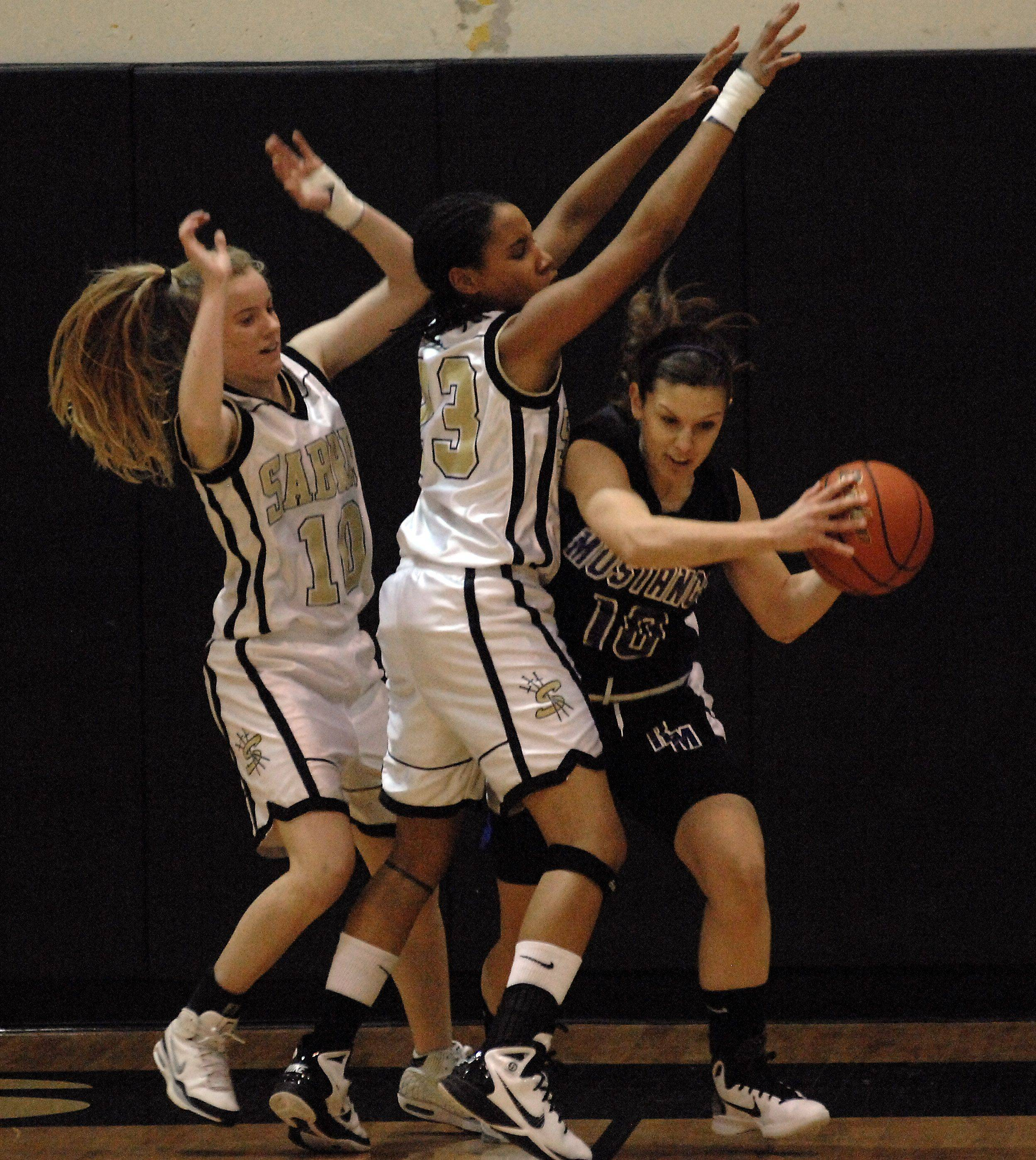 Streamwood's Amanda Patterson and Deja Moore guard Rolling Meadows' Madelynn Conlin during Monday's game in Streamwood.