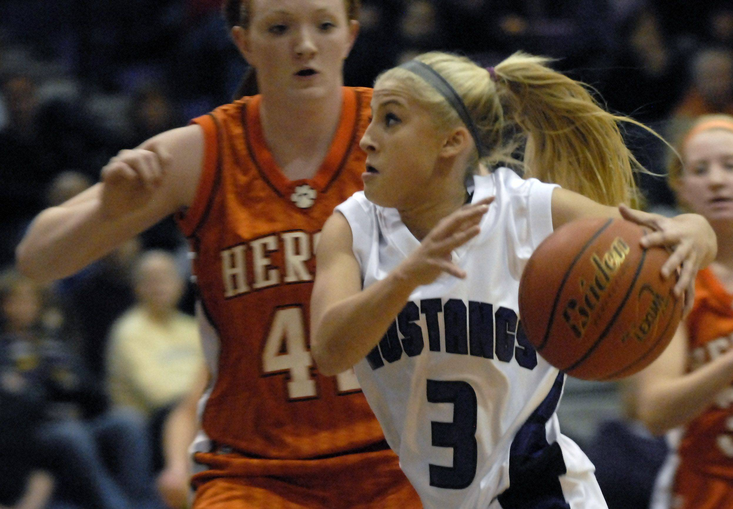 Rolling Meadows' Jacqueline Kemph drives in the lane against Hersey's Maggie Hogen Friday night at Rolling Meadows.