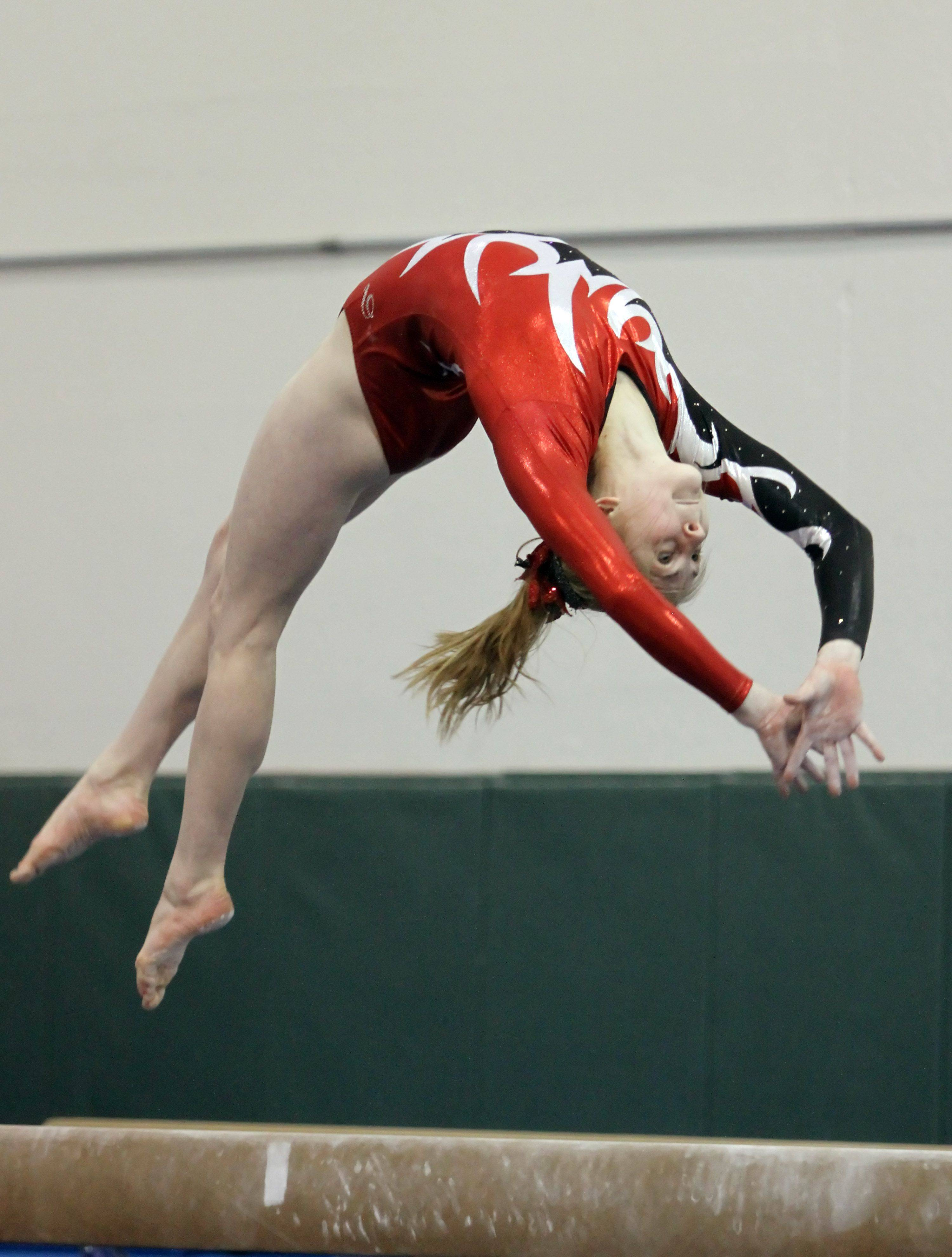 Barrington's Marissa Krzysko competes on the beam Monday in Vernon Hills.