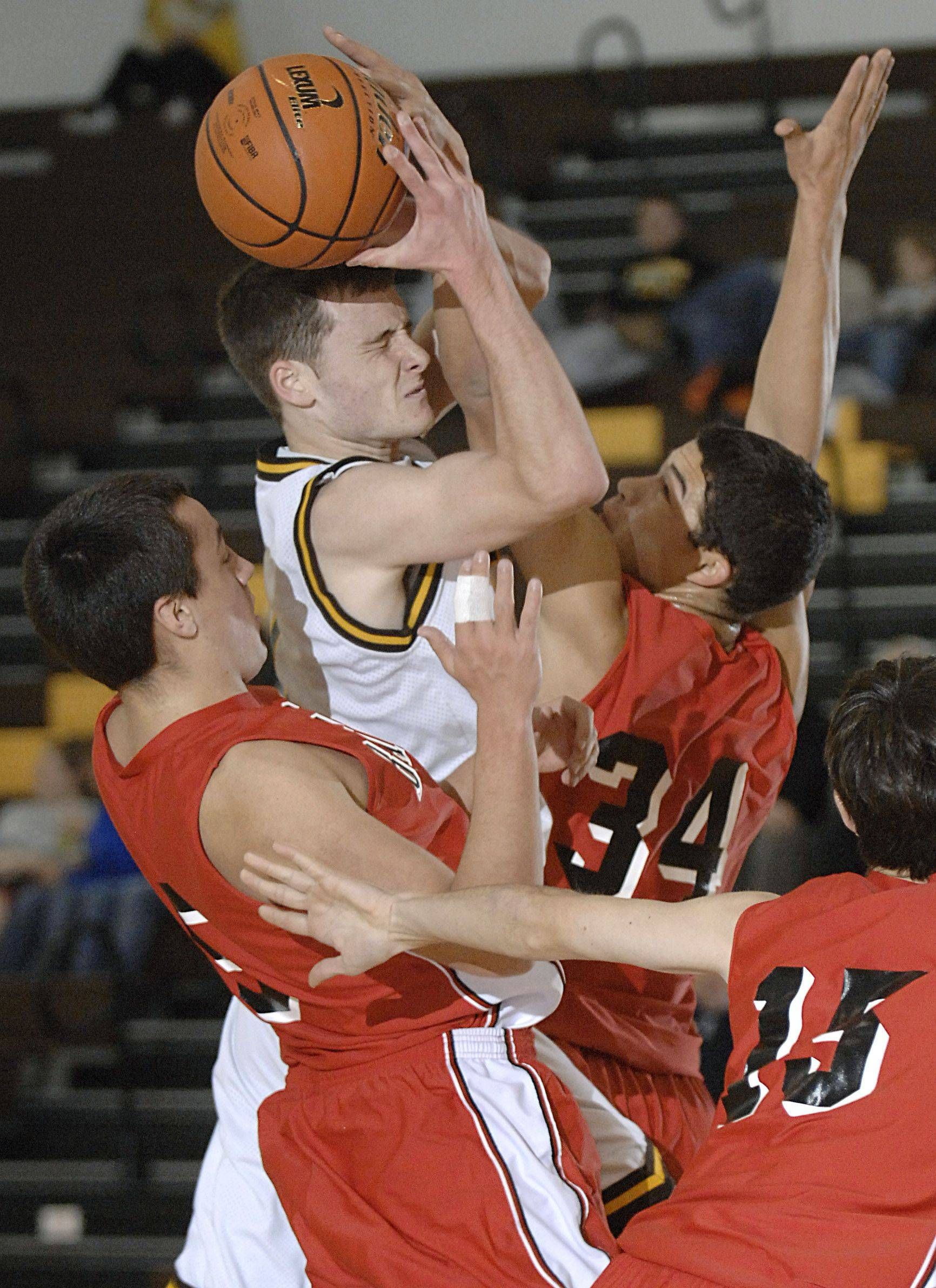 Barrington's Owen Prunskis attempts to block Jacobs' Nick Hofman in the first quarter of Tuesday's game.