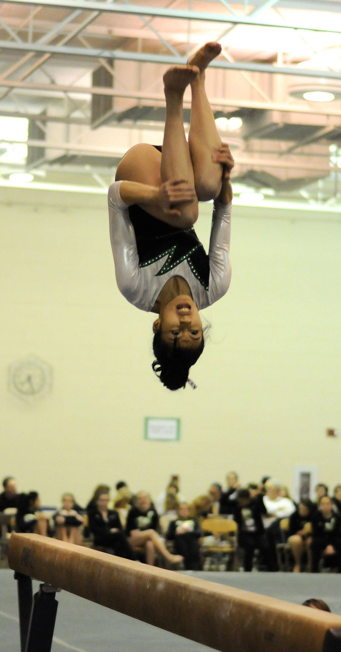 Glenbard West's Abbie Garchitorena on the balance beam during the York at Glenbard West girls gymnastics meet Wednesday.