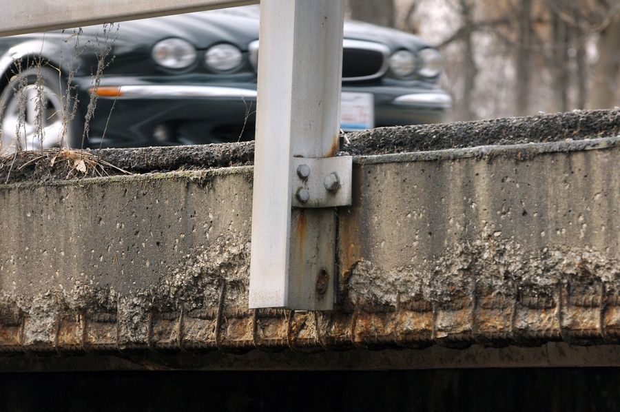 "Inspectors have declared this bridge carrying Milwaukee Avenue over a small stream just north of Route 137 in Libertyville deficient because of ""serious"" deterioration to the road and supporting structures of the bridge."