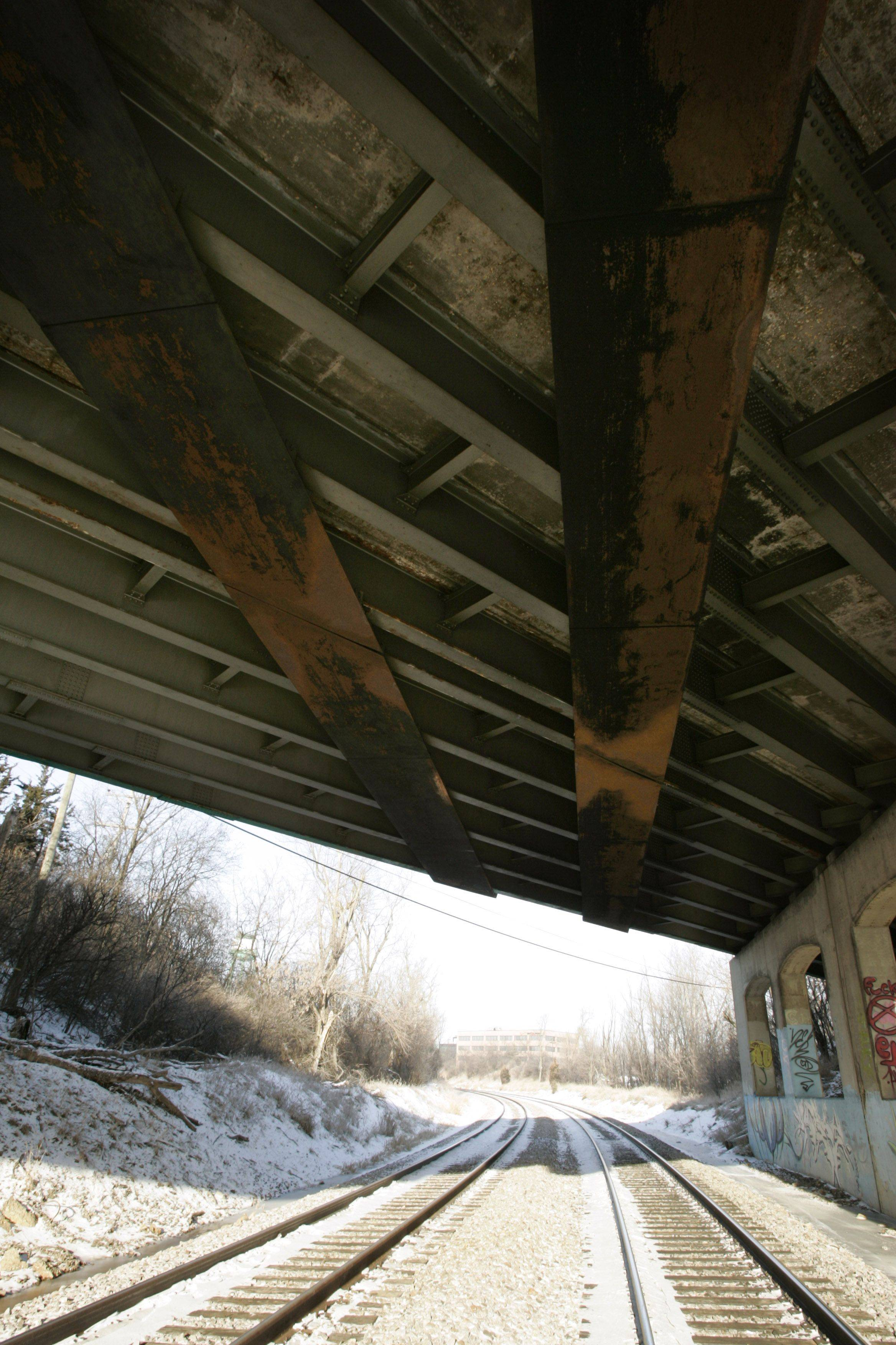 The Route 31 bridge over railroad tracks in Elgin is one of 293 rated structurally deficient in the six-county Chicago and suburban region. Inspections show it's in poor condition.