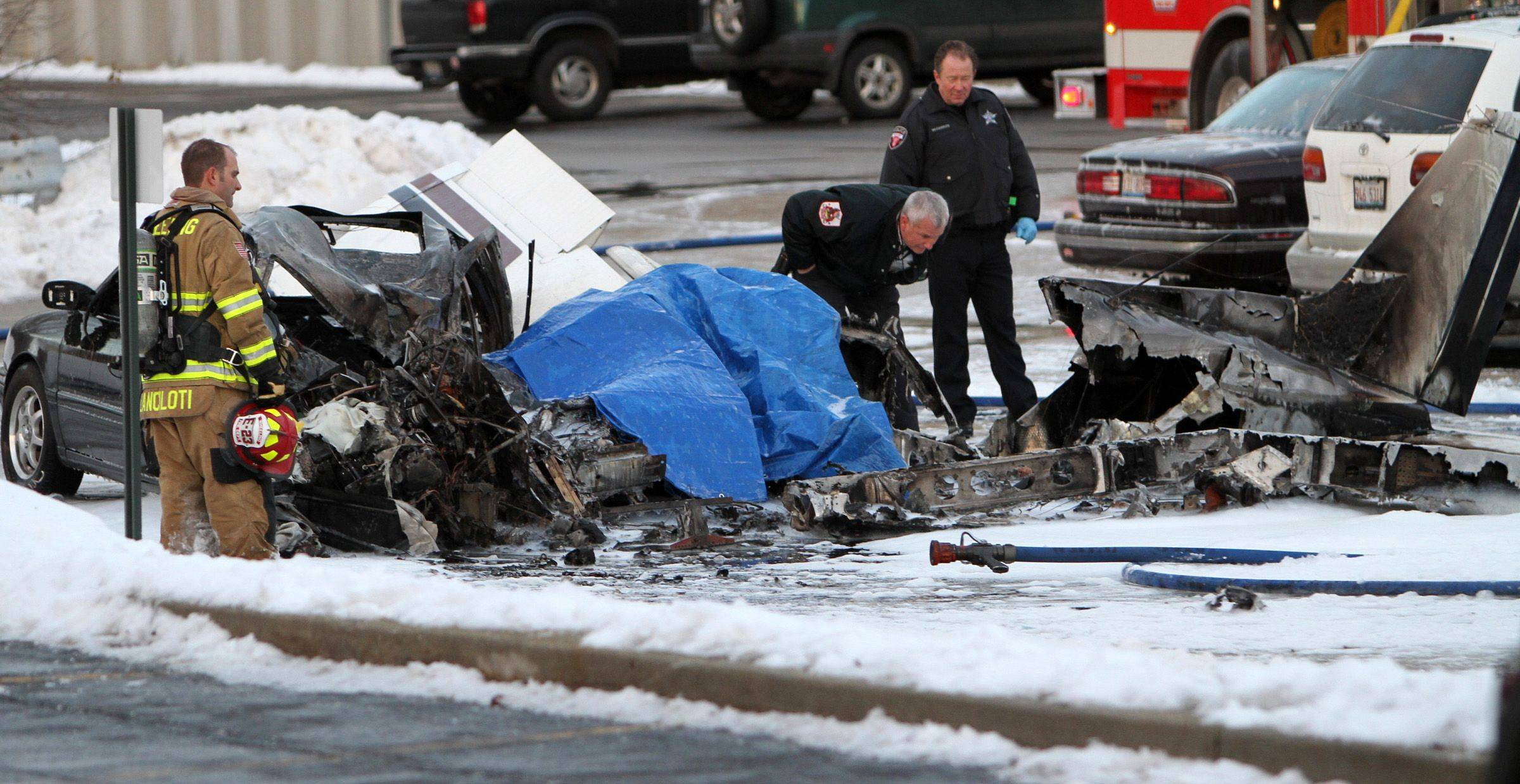 A small plane crashed on two cars in a parking lot at Chaddick Drive and Hintz Road in Wheeling on Wednesday.