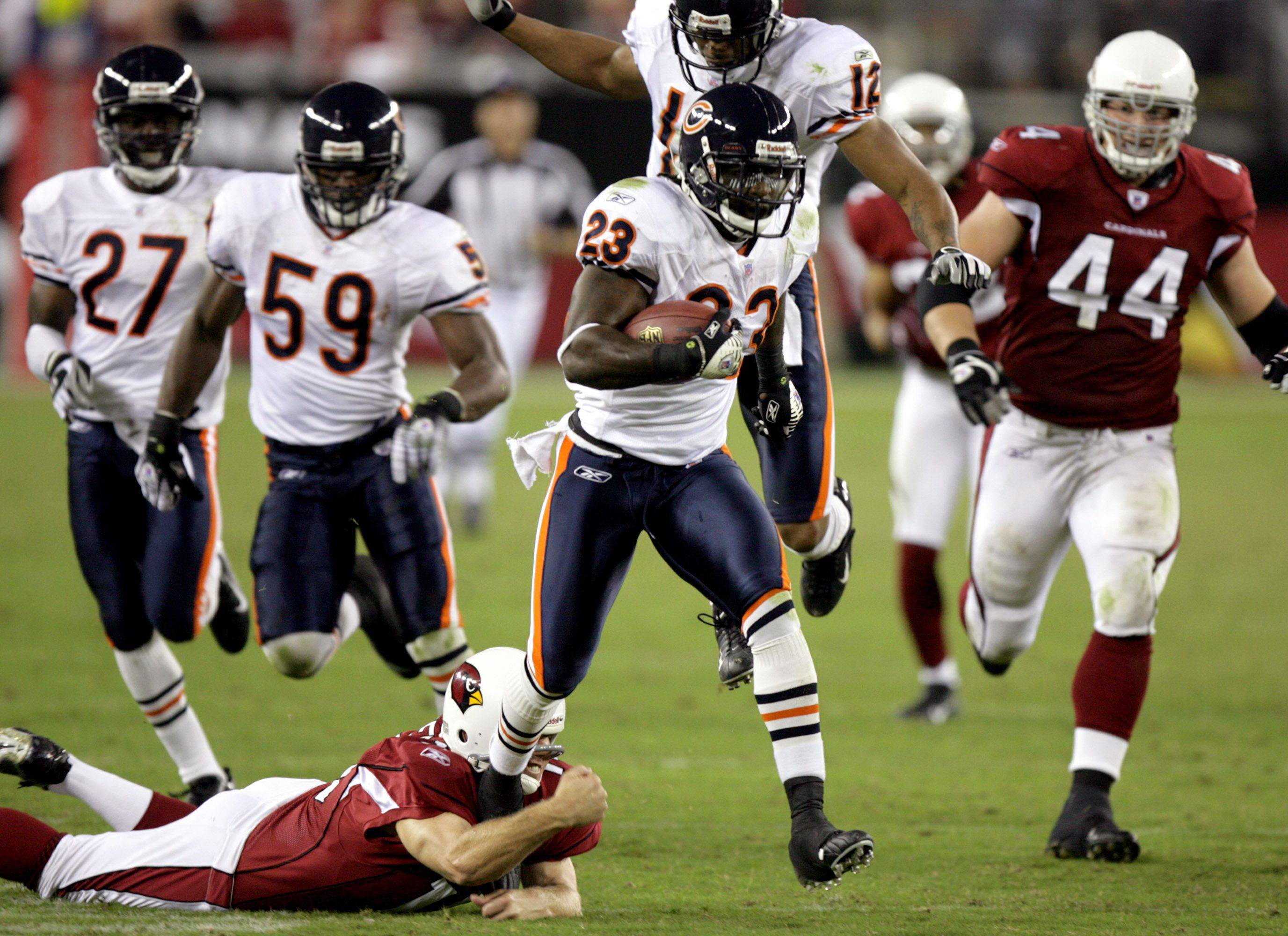No. 2: Devin Hester breaks away from a tackle attempt by Arizona Cardinals punter Scott Player for an 83-yard punt return for a touchdown on Oct. 16, 2006.
