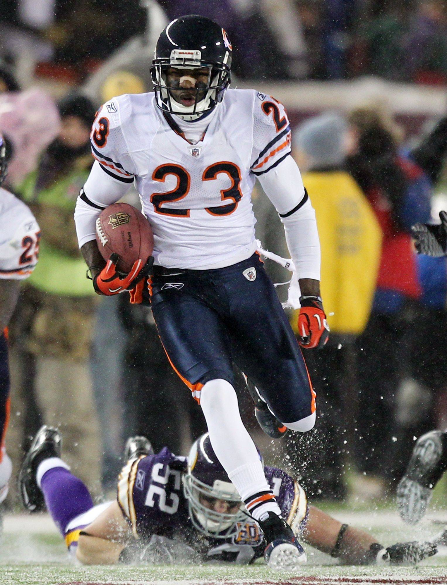 No. 14: Devin Hester breaks away from Minnesota Vikings' Chad Greenway for a 64-yard touchdown on a punt return on Dec. 20, 2010 in Minneapolis to break the all-time NFL record for kick returners.