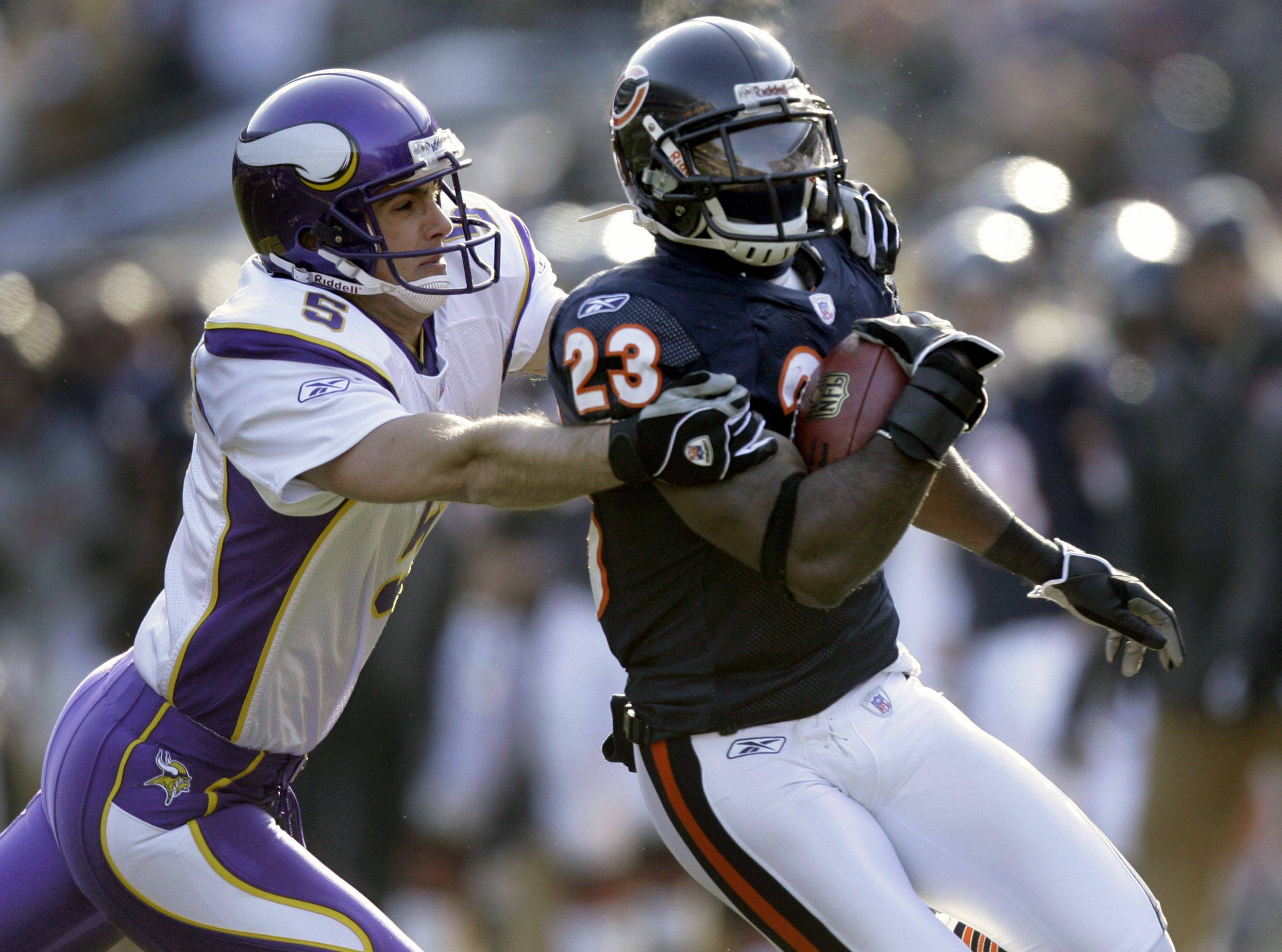 No. 3: Minnesota Vikings punter Chris Kluwe, left, grabs the Bears' Devin Hester as Hester heads to the end zone for a 45-yard punt return for a touchdown against the Vikings on Dec. 3, 2006.