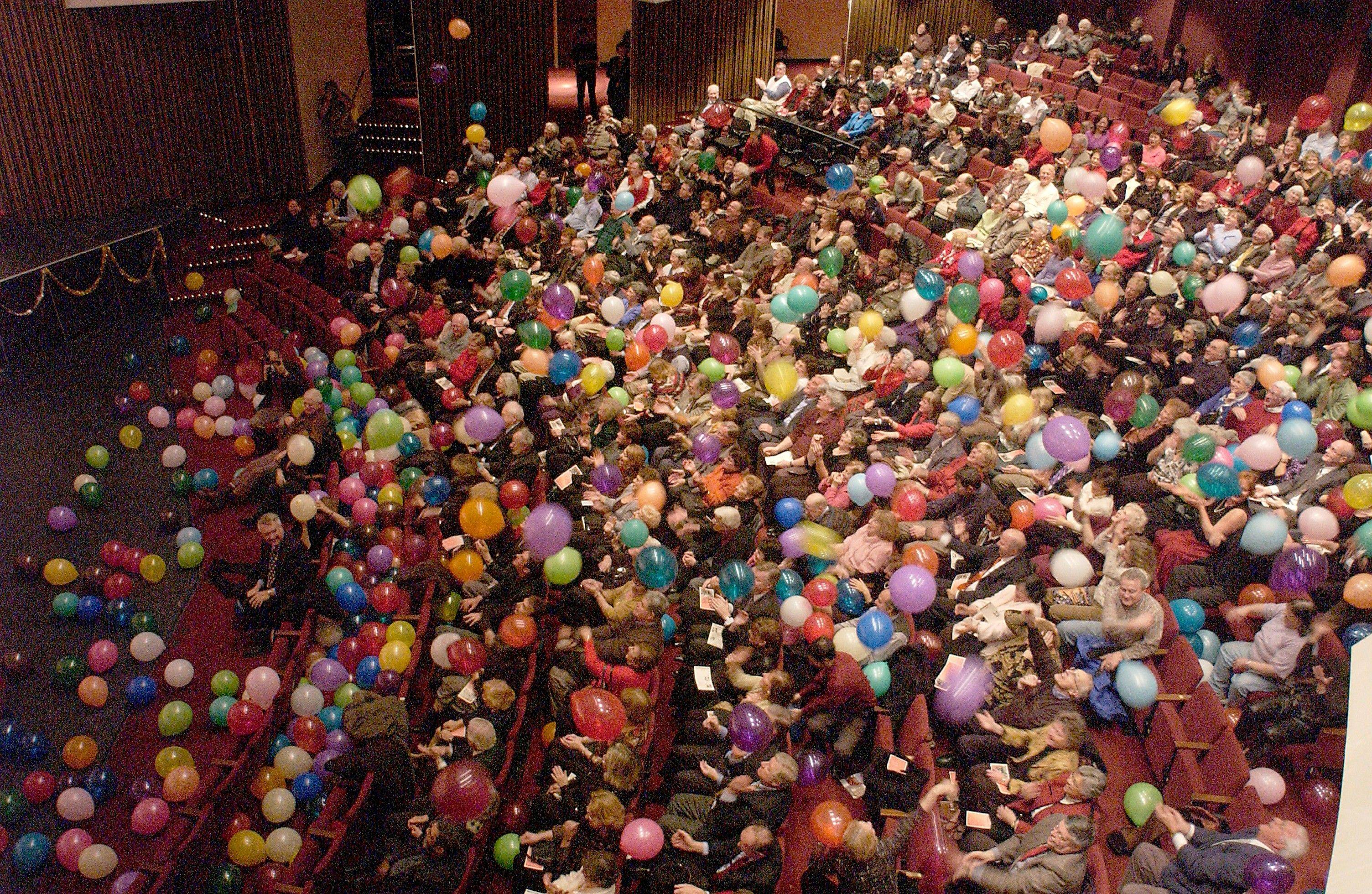 Balloons fall on a previous audience at the New Philharmonic's New Year's Eve concerts at College of DuPage's McAninch Arts Center in Glen Ellyn.