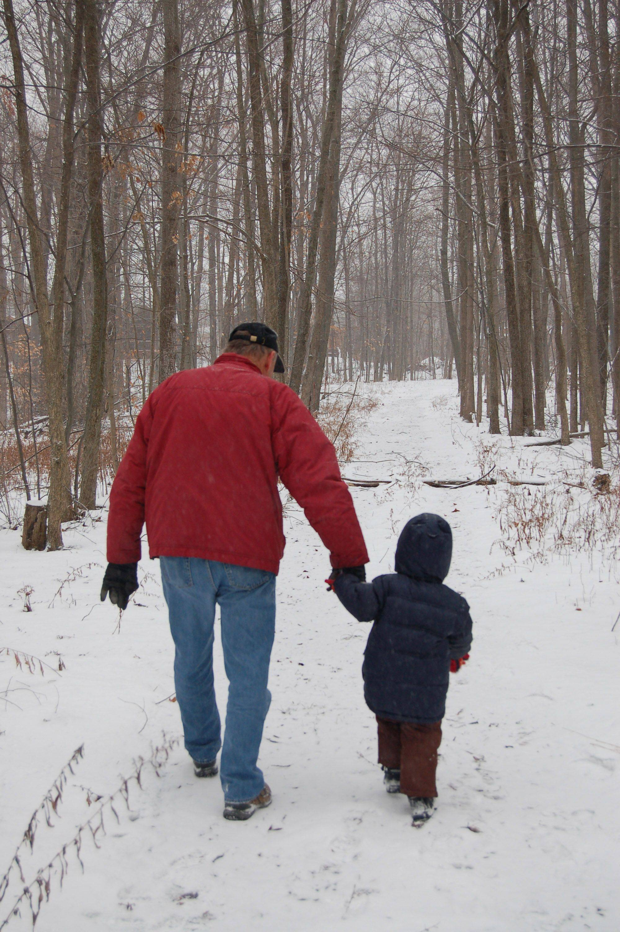 Peter Cooper takes a cold winter walk with his grandson, Nic Nitti, near his cabin in Union Pier, Mich.