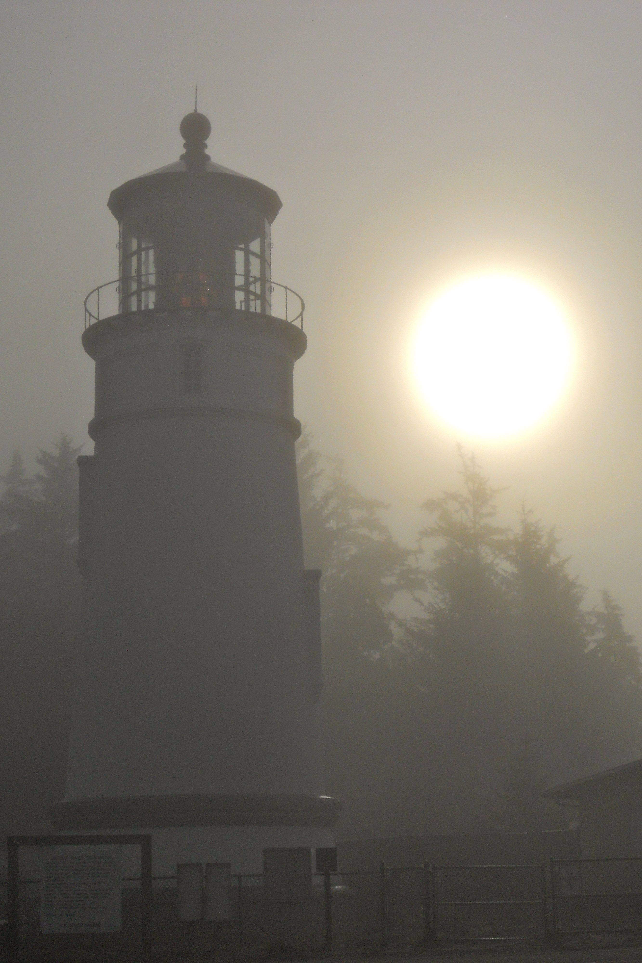 This is the Umqua Lighthouse at Winchester Bay on the coast of Oregon. The fog was thick on the coast that morning in September 2010.