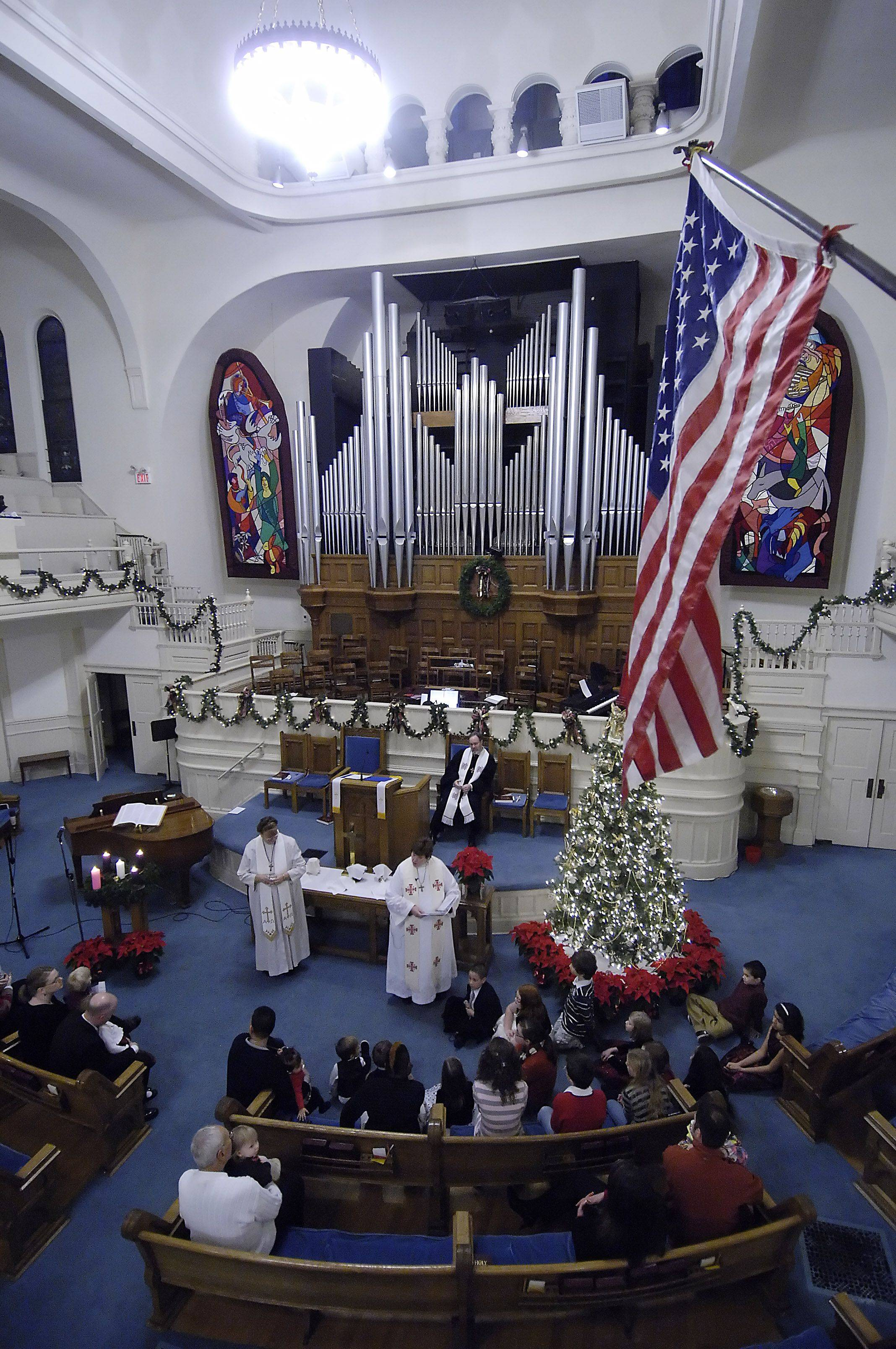 Children are blessed by Pastor Dr. Paris Donehoo during a Christmas Eve service at First Congregational United Church of Christ in Elgin.