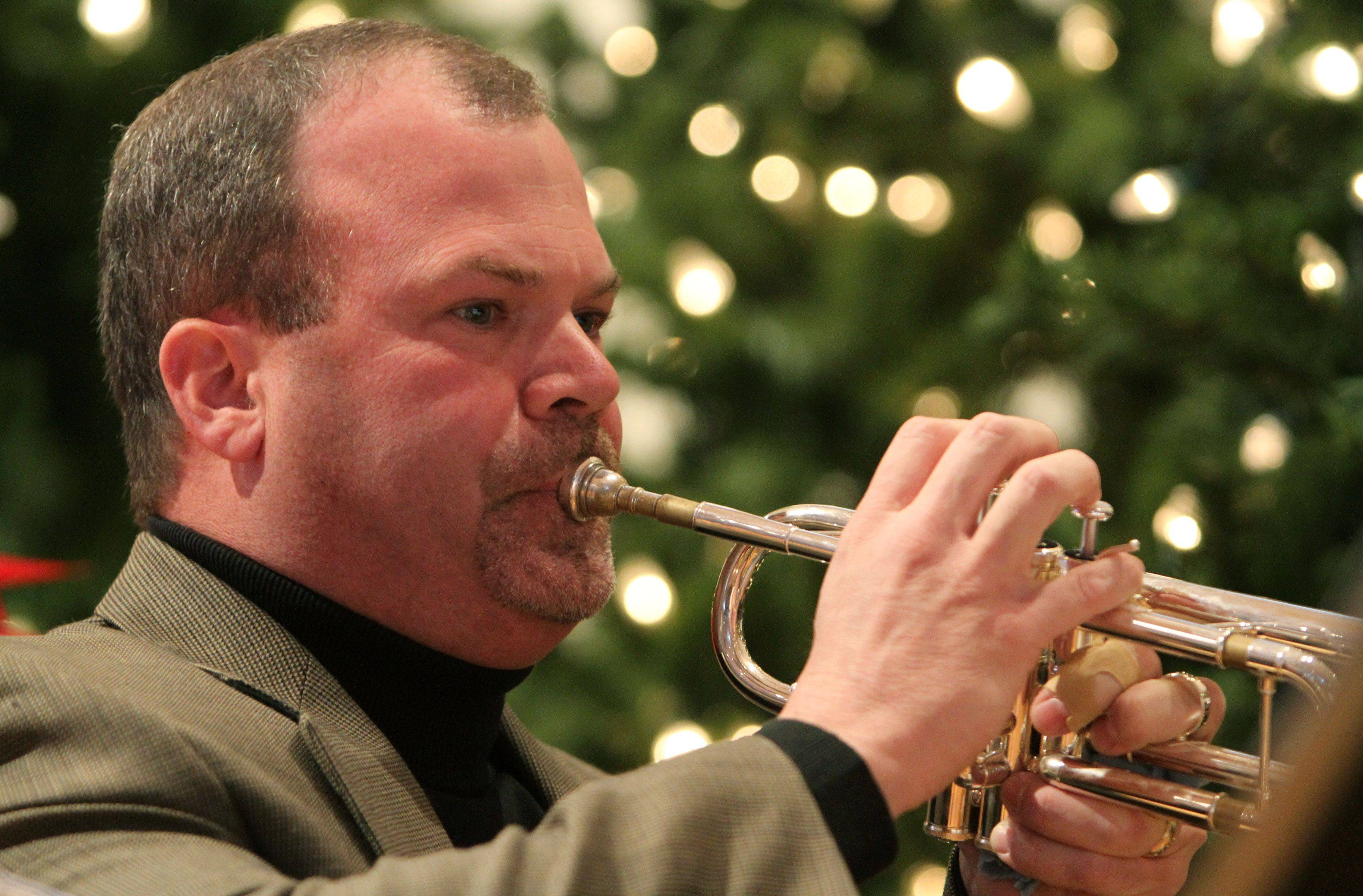 Joe Perry plays the trumpet during Christmas carols at St. Paul the Apostle Catholic Church in Gurnee Christmas Eve.