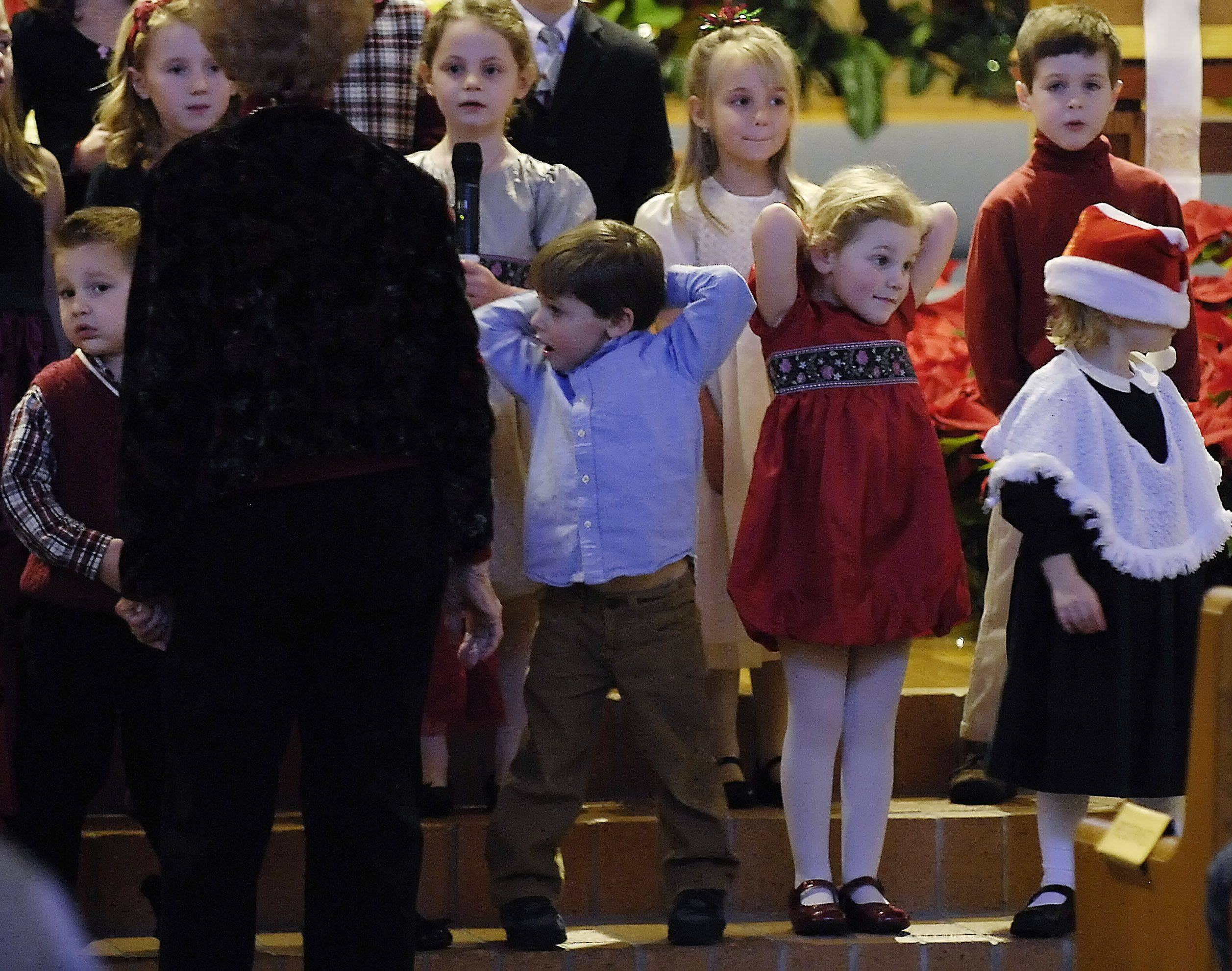 Cherub Choir members participate in a Christmas Eve service at Fox Valley Presbyterian Church in Geneva.