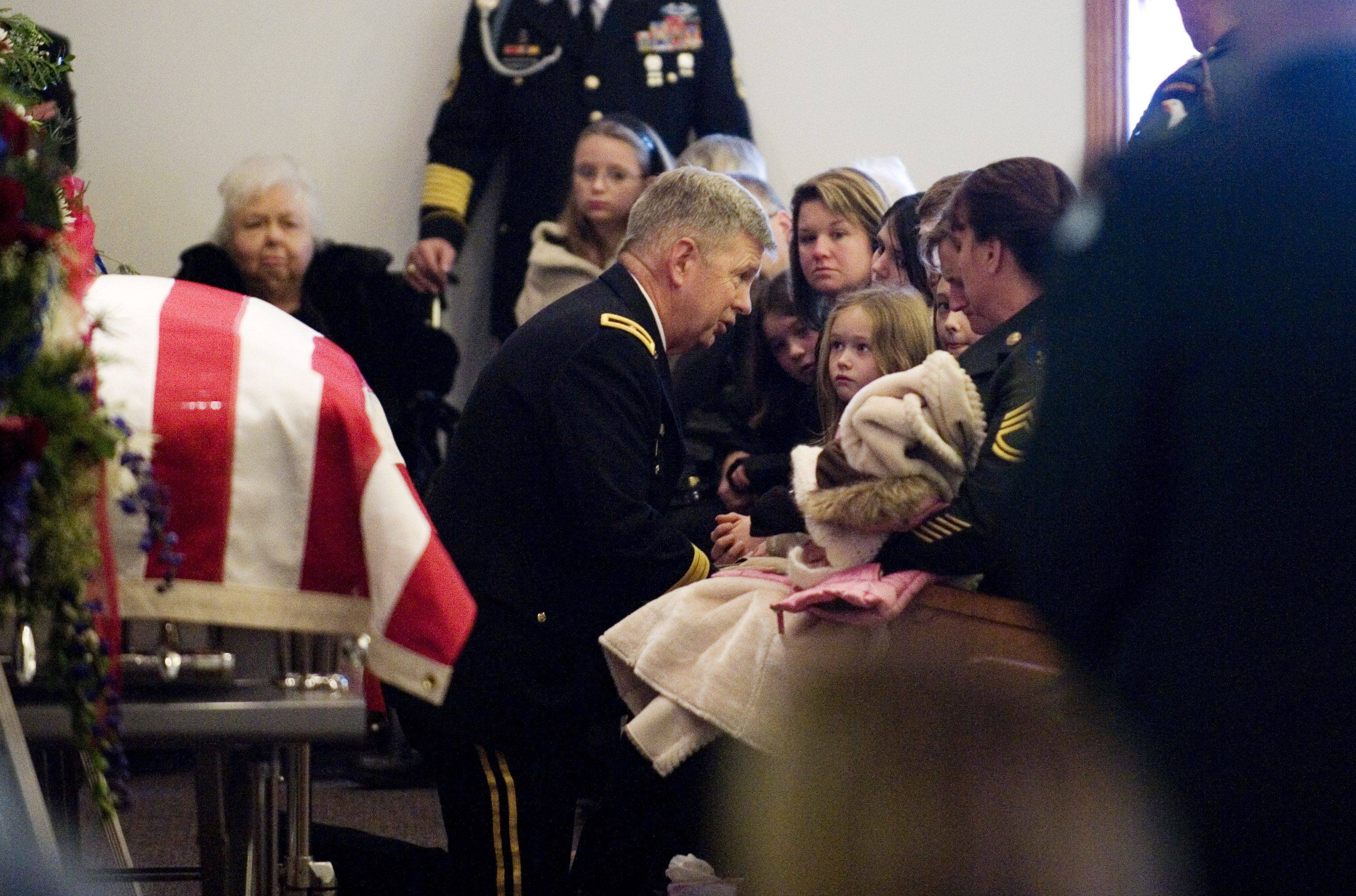 "On Dec. 9, Brig. Gen. William ""Tim"" Crosby presented the purple heart, bronze star and the meritorious service medal to the family of Army Sgt. Barry Jarvis, 36, at Deer Creek Baptist Church in Tell City, Ind. Jarvis, a member of the 101st Airborne Division in Ft. Campbell, Ky., was one of six soldiers killed Nov. 29 in Afghanistan when a rogue Afghan border policeman turned his gun on his American trainers as the group headed to shooting practice."