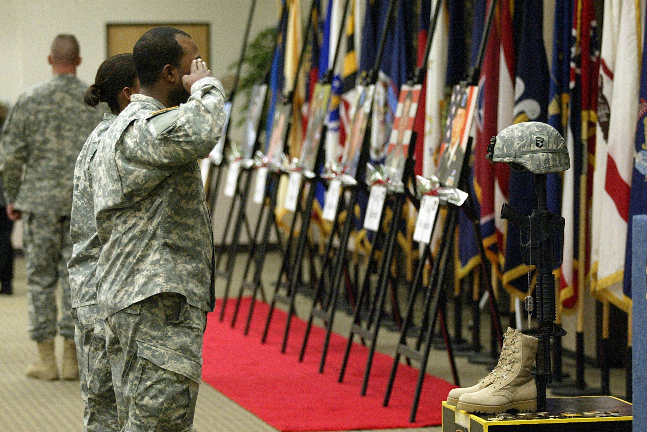On Dec. 8, soldiers paid their final respects to 13 fallen soldiers during the monthly Eagle Remembrance Ceremony at the Family Resource Center at Fort Campbell, Ky. The famed 101st Airborne Division shows the scars of the U.S. surge in Afghanistan.
