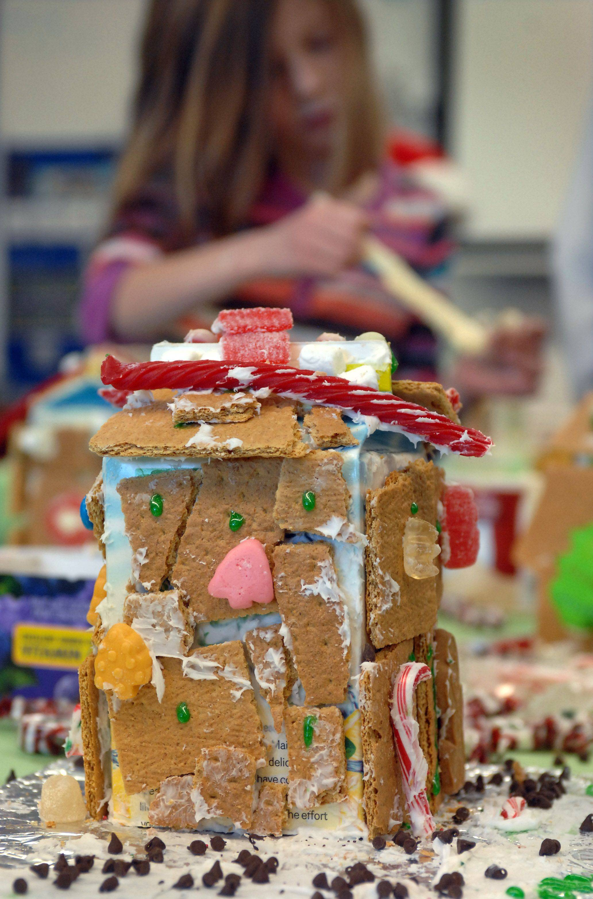 Brielle Rochester's gingerbread house comes together Friday at Adler Park School in Libertyville.
