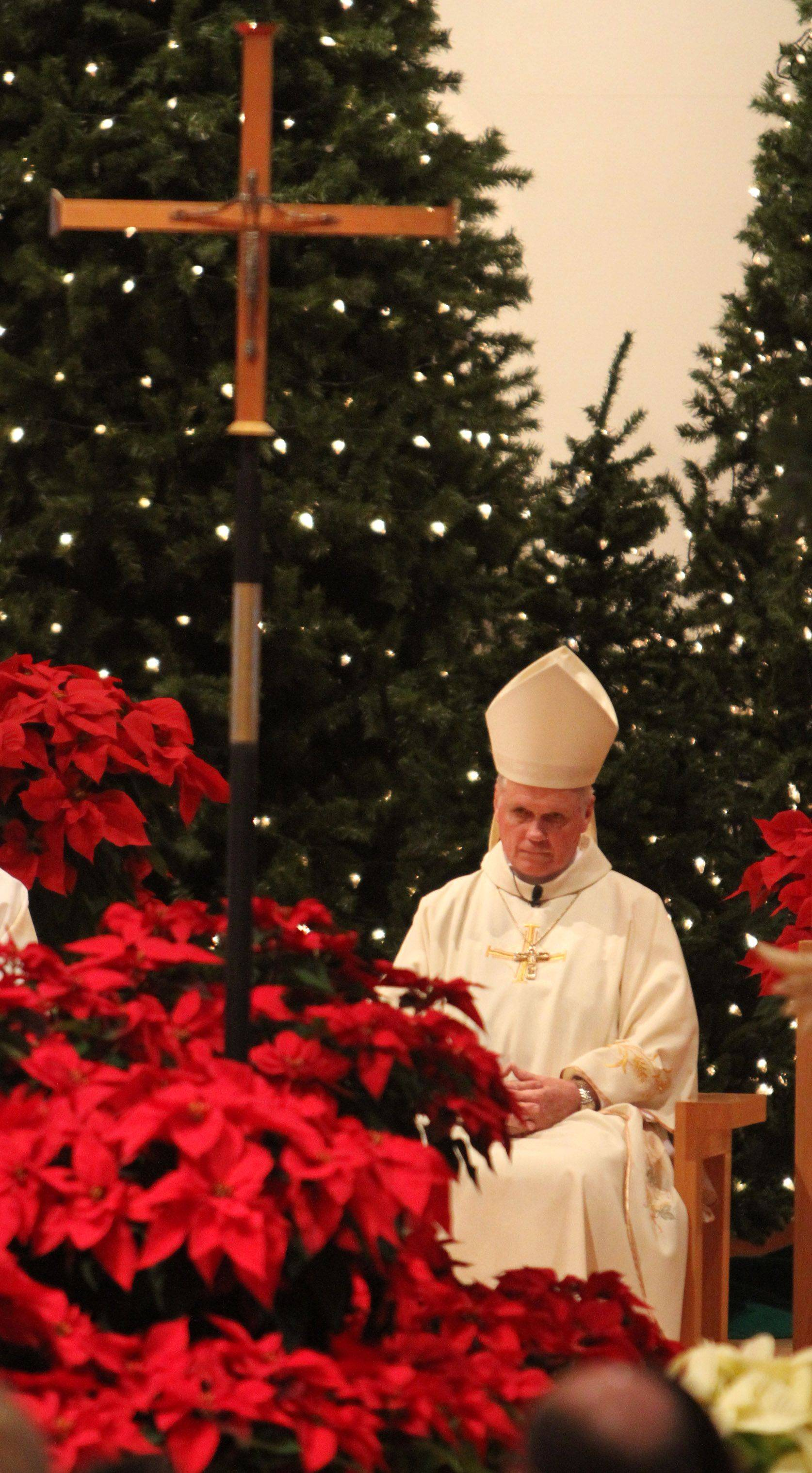 St. Paul the Apostle Catholic Church held mass with Auxiliary Bishop of the Archdiocese of Chicago George Rassas in Gurnee on Christmas Eve.