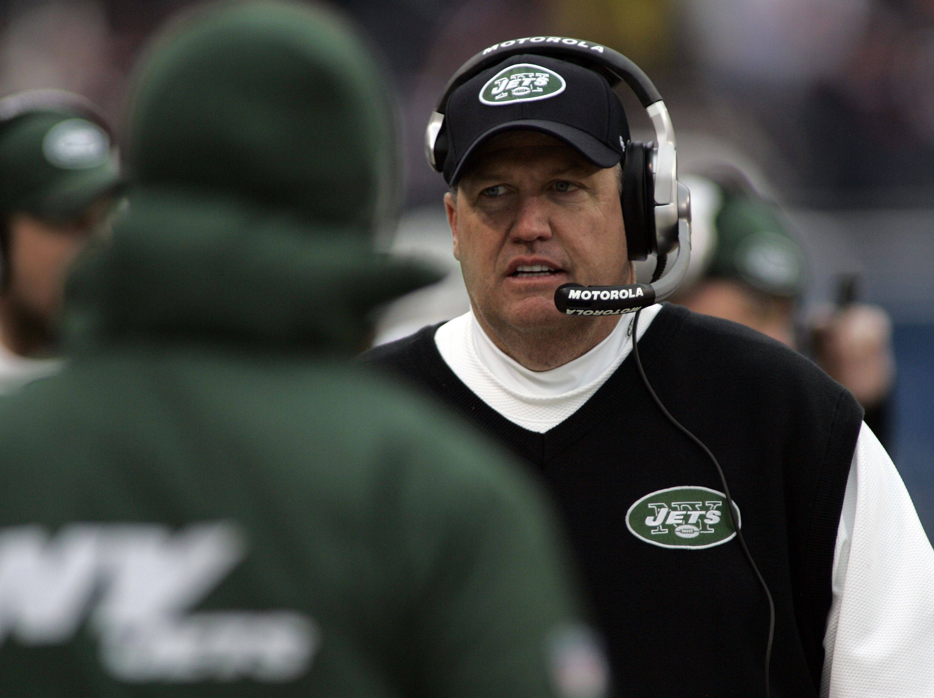 Coach Rex Ryan and the New York Jets lost to the Bears but won a playoff berth Sunday by virtue of the Redskins' victory over the Jaguars.