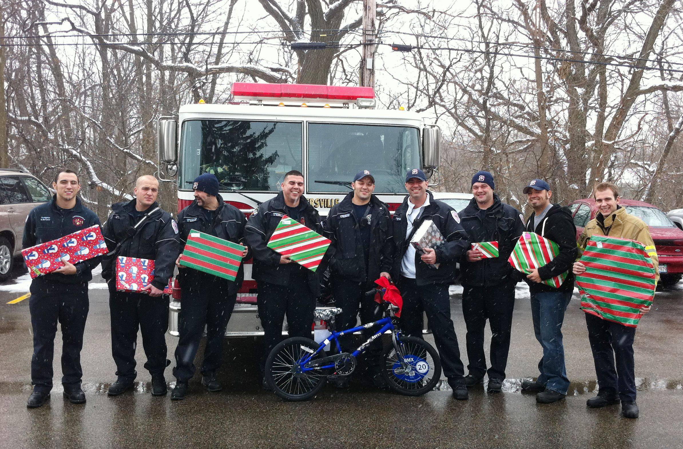 Carpentersville firefighters, from left, Nick Bertucci, Matt Jackson, Brandon Wemken, Art Carrillo, Tony Ferreiro, Brian Berry, Dave Johnson, Doug Miller and Scott Kapocious prepare to hand out Christmas gifts.