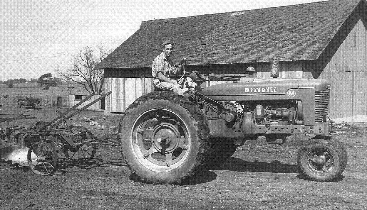 Tom Peck works the family farm in 1948.