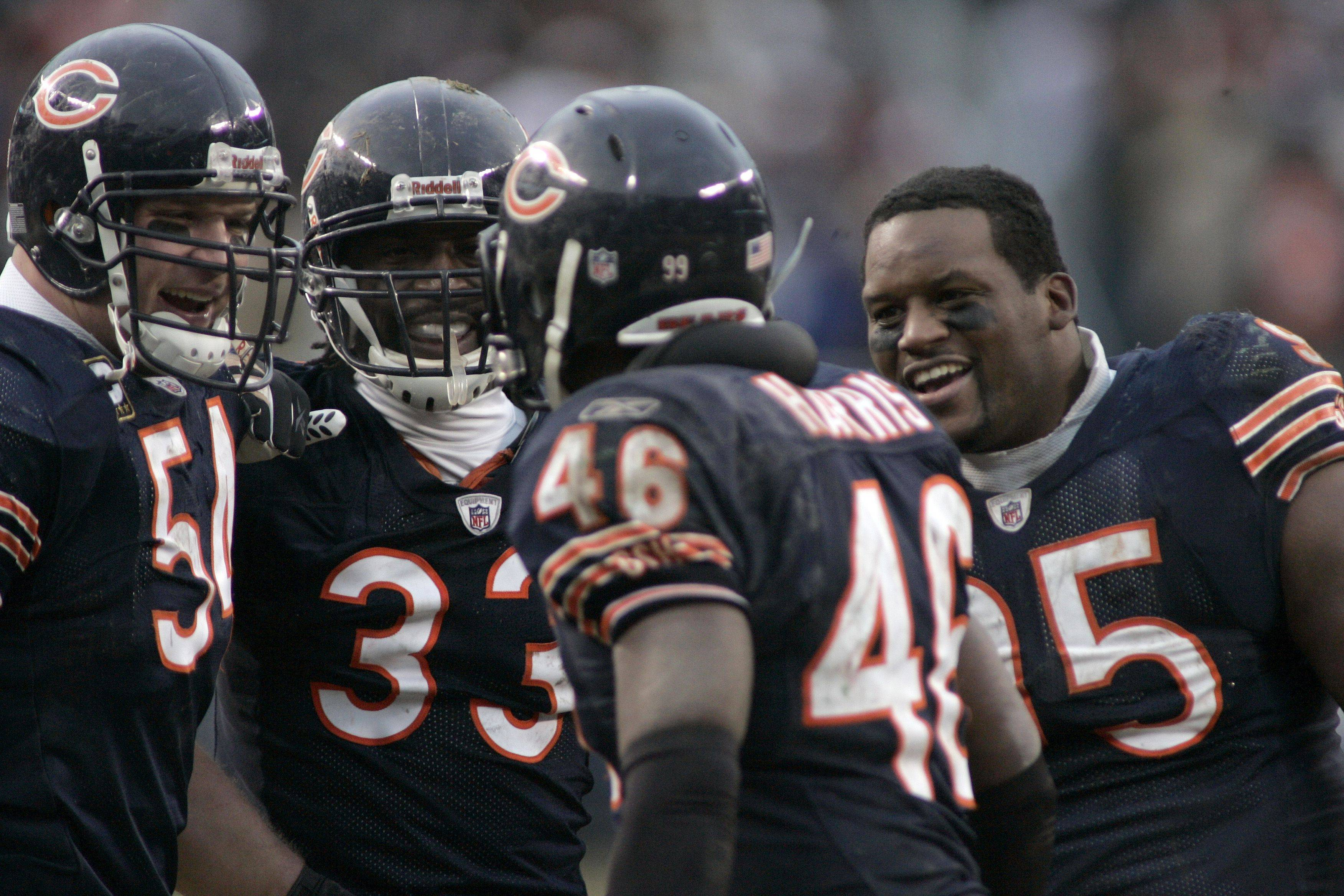 Bears safety Chris Harris (46) celebrates with his team after pulling in an interception to change the direction of the game during the Chicago Bears and New York Jets game at Soldier Field in Chicago Sunday, December 26, 2010. Chicago Bears linebacker Brian Urlacher (54) from left, Chicago Bears cornerback Charles Tillman (33) and Chicago Bears defensive tackle Anthony Adams (95).