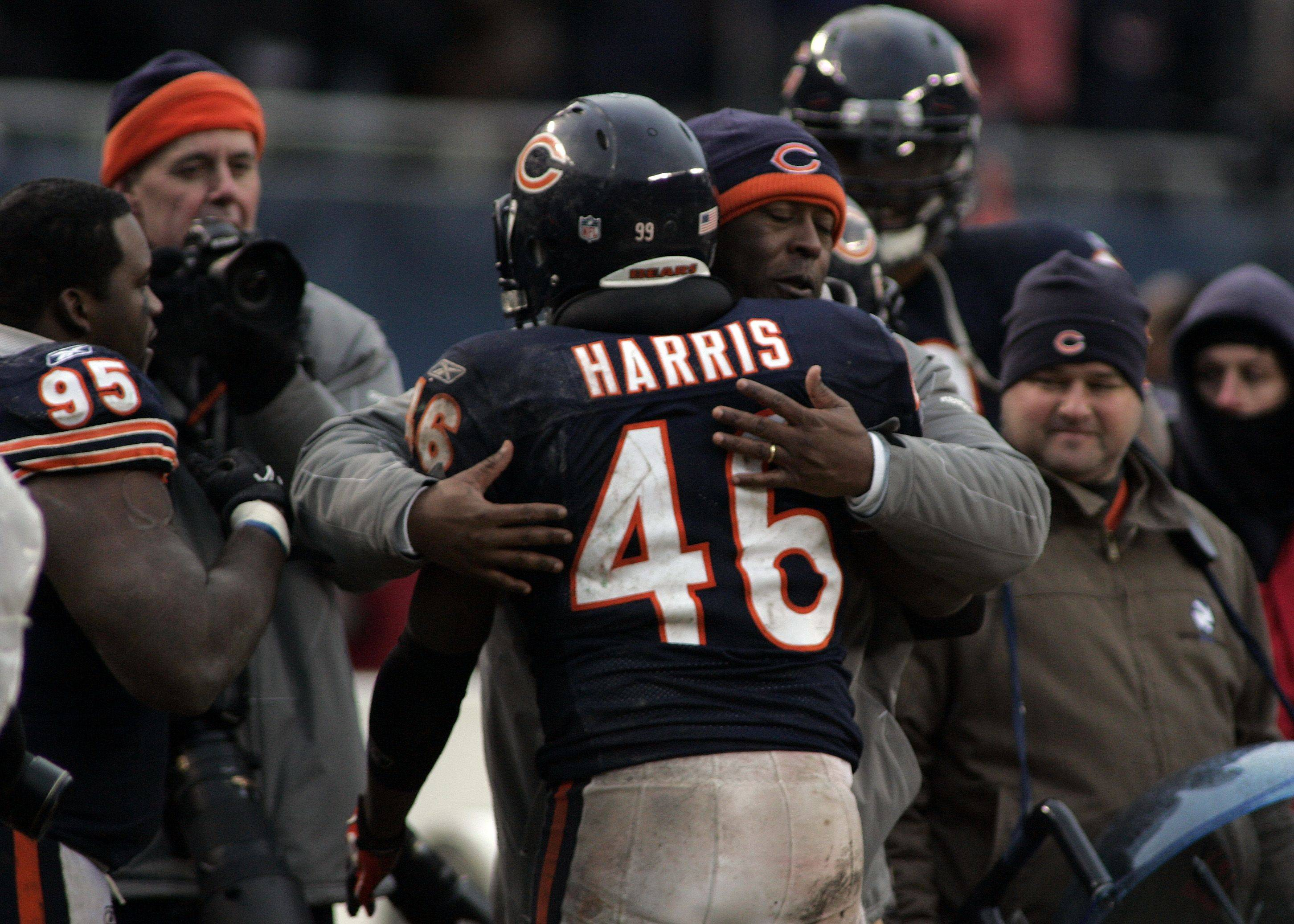 Bears coach Lovie Smith hugs safety Chris Harris (46) after he pulled in an interception to clinch Sunday's victory over the Jets at Soldier Field.